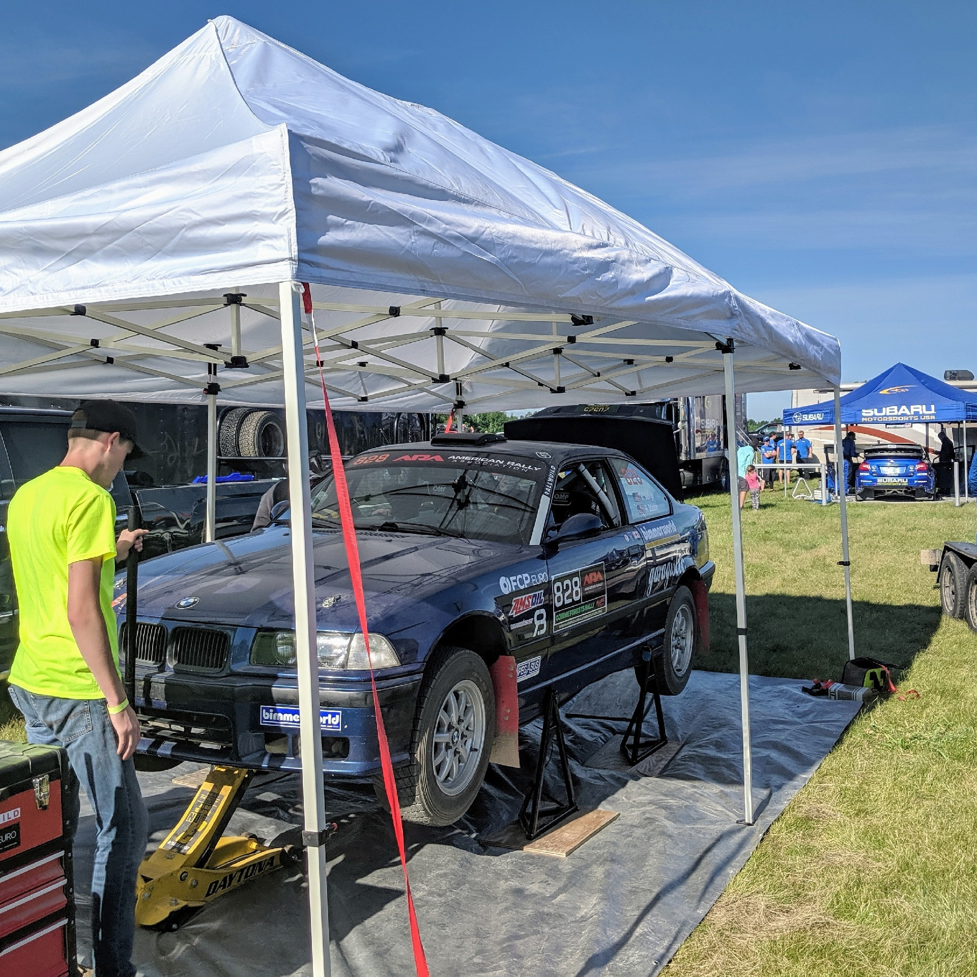 Bearded Ryno Rally Team Ojibwe Forest Rally Service on Pin Stands BMW M3 E36