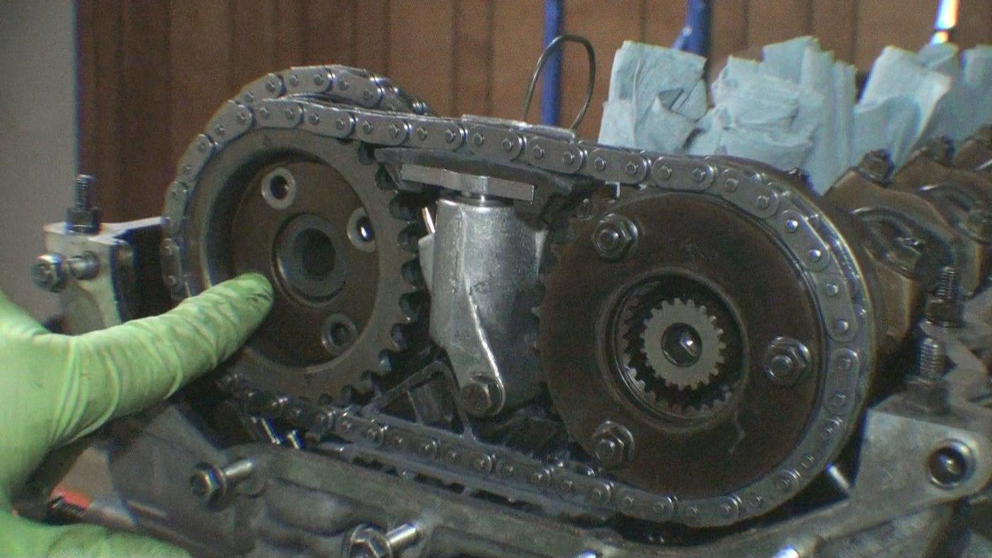 thrust washers onto camshaft sprockets