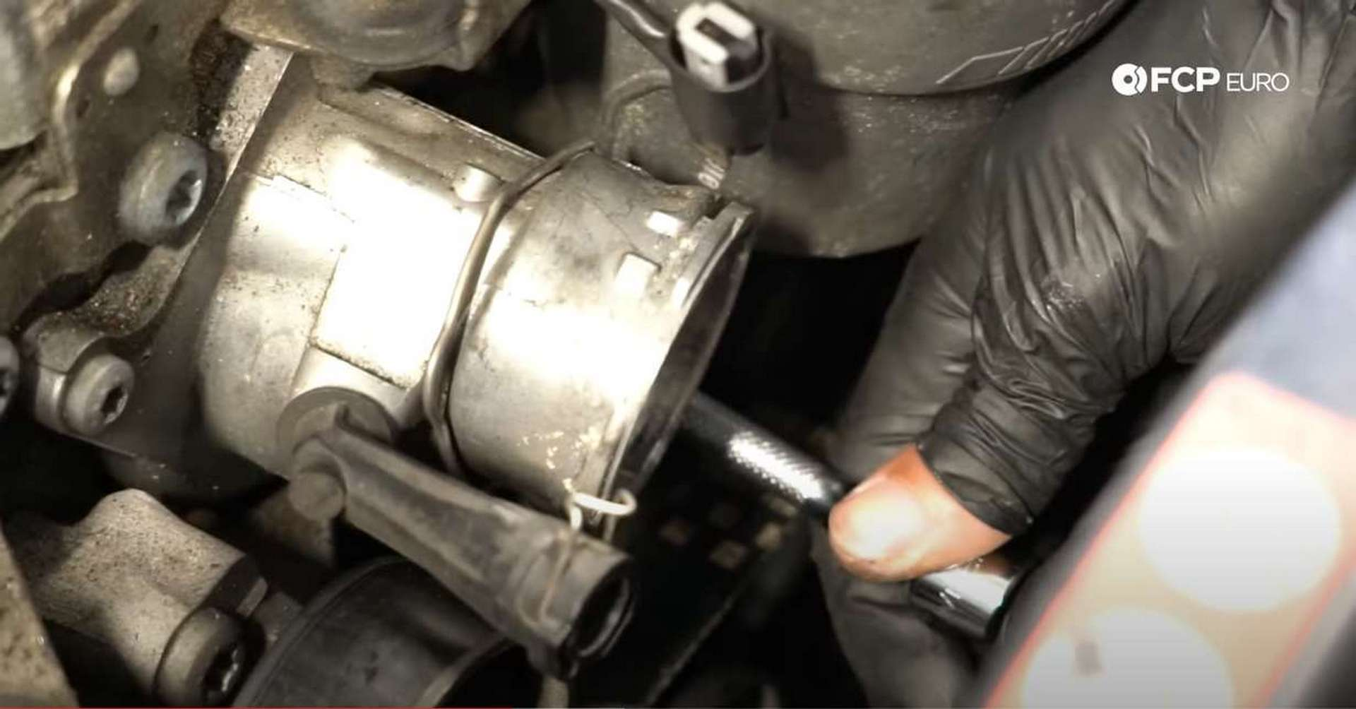M156 Thermostat Replacement removing lower bolt