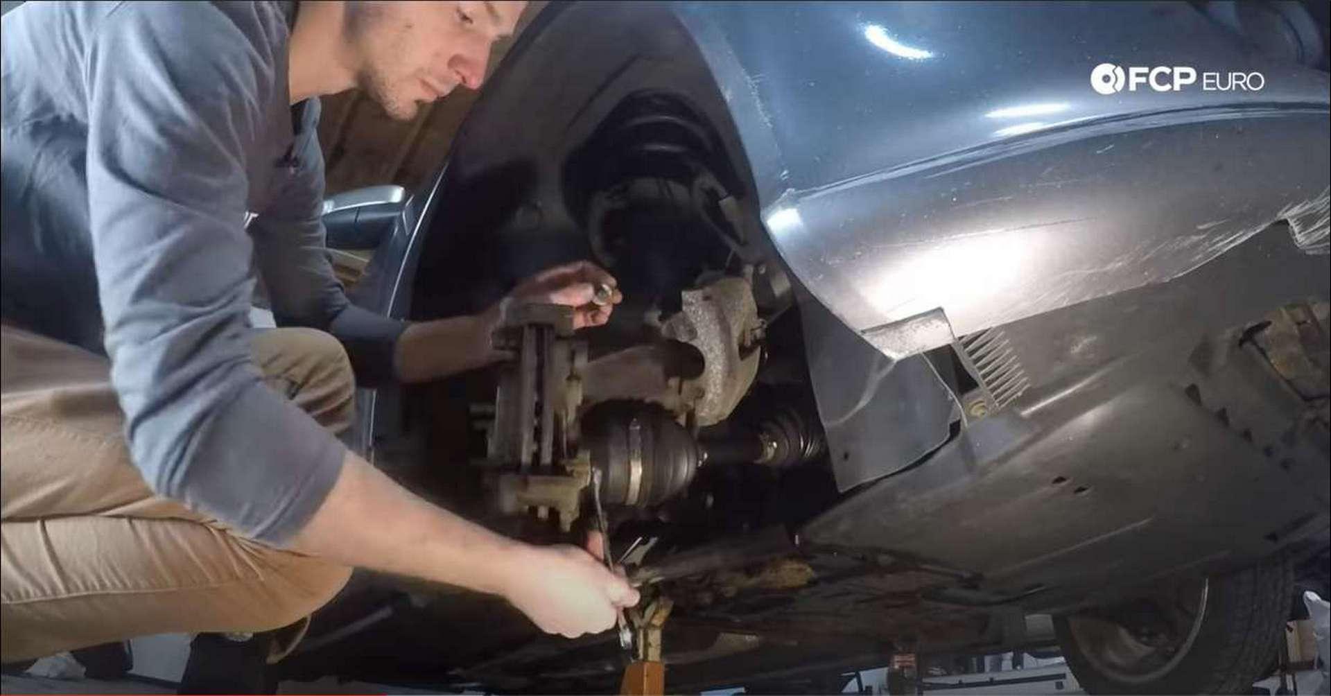 Volvo C30 Front Brakes removing caliper bracket bolts