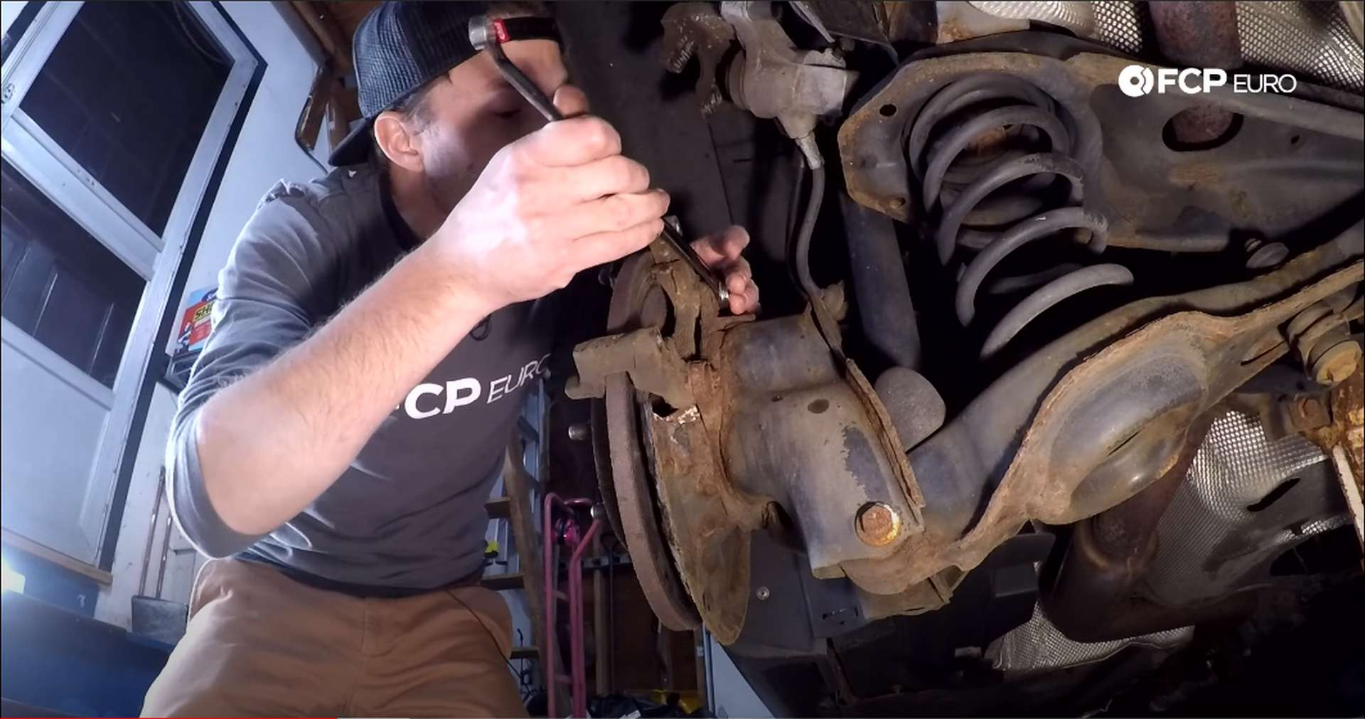 DIY Volvo Rear Brake Job loosening bracket bolts