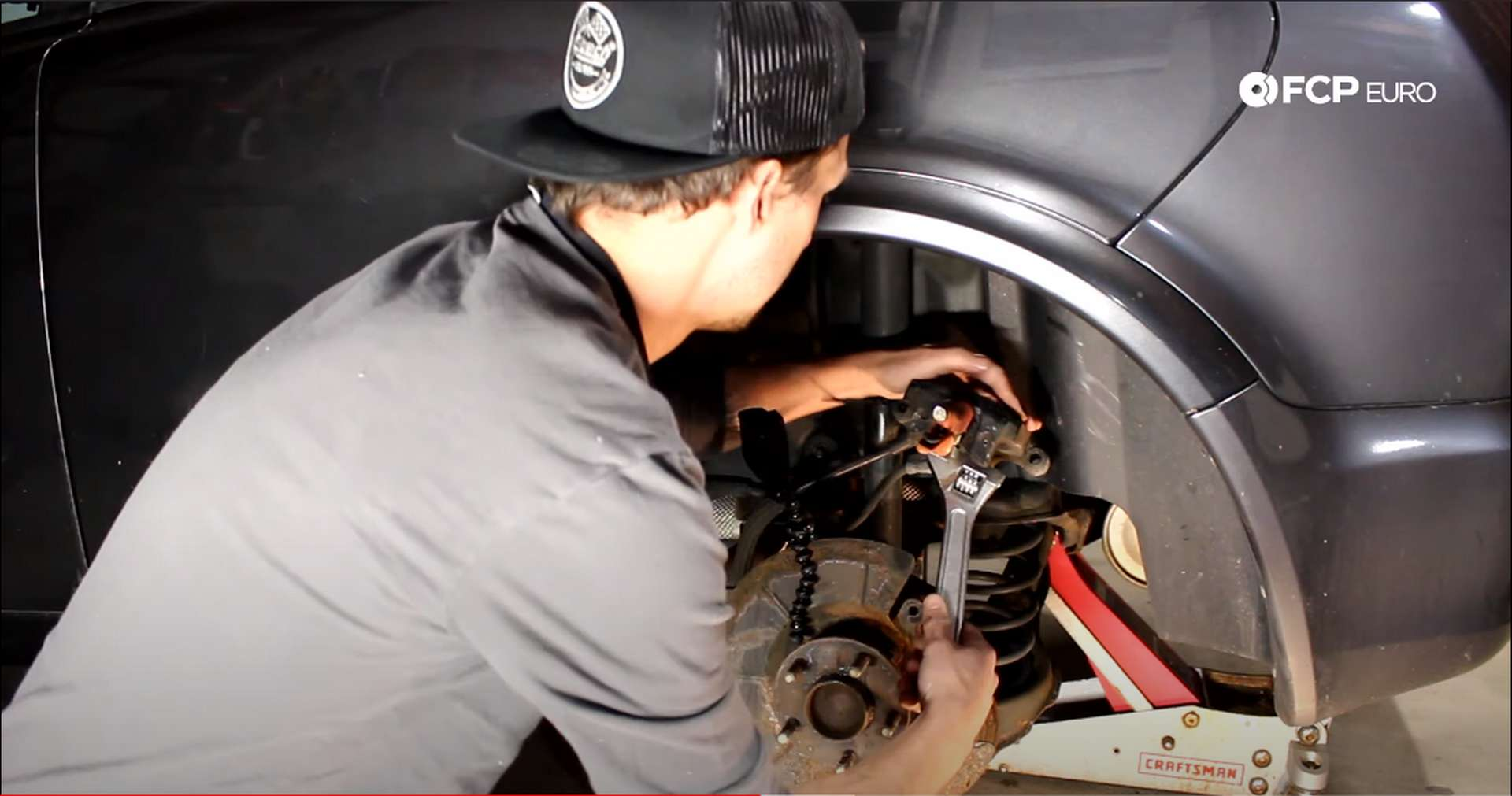 DIY Volvo Rear Brake Job turning pliers with the wrench