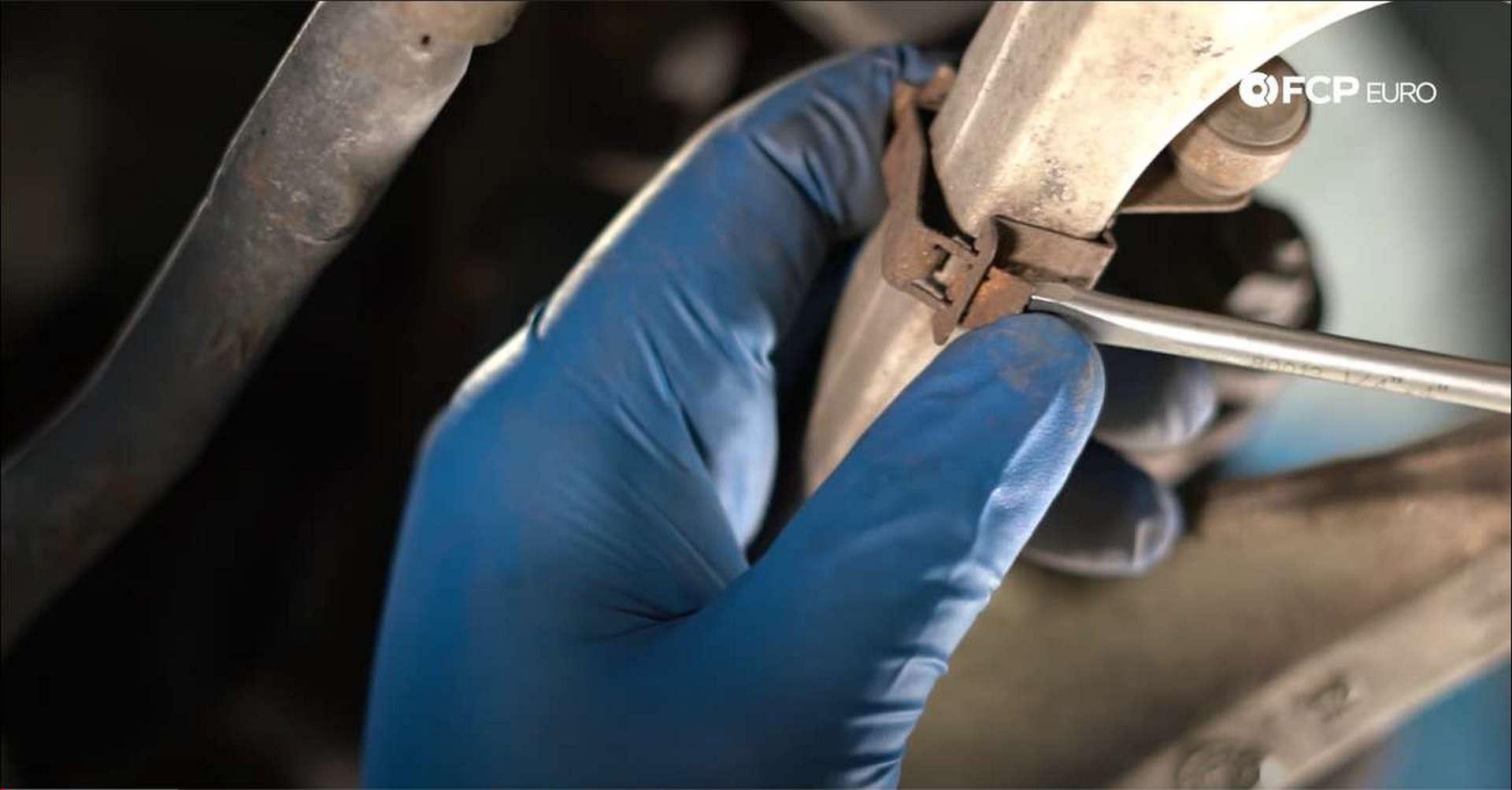 DIY BMW Front Suspension Refresh removing headlight sensor