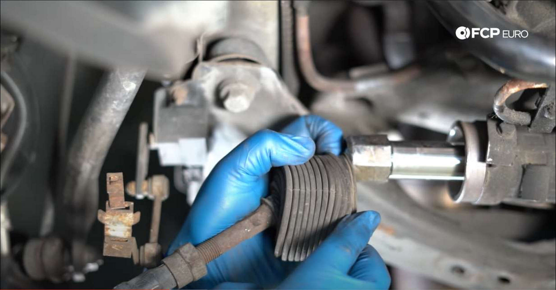 DIY BMW Front Suspension Refresh exposing tie rod nut
