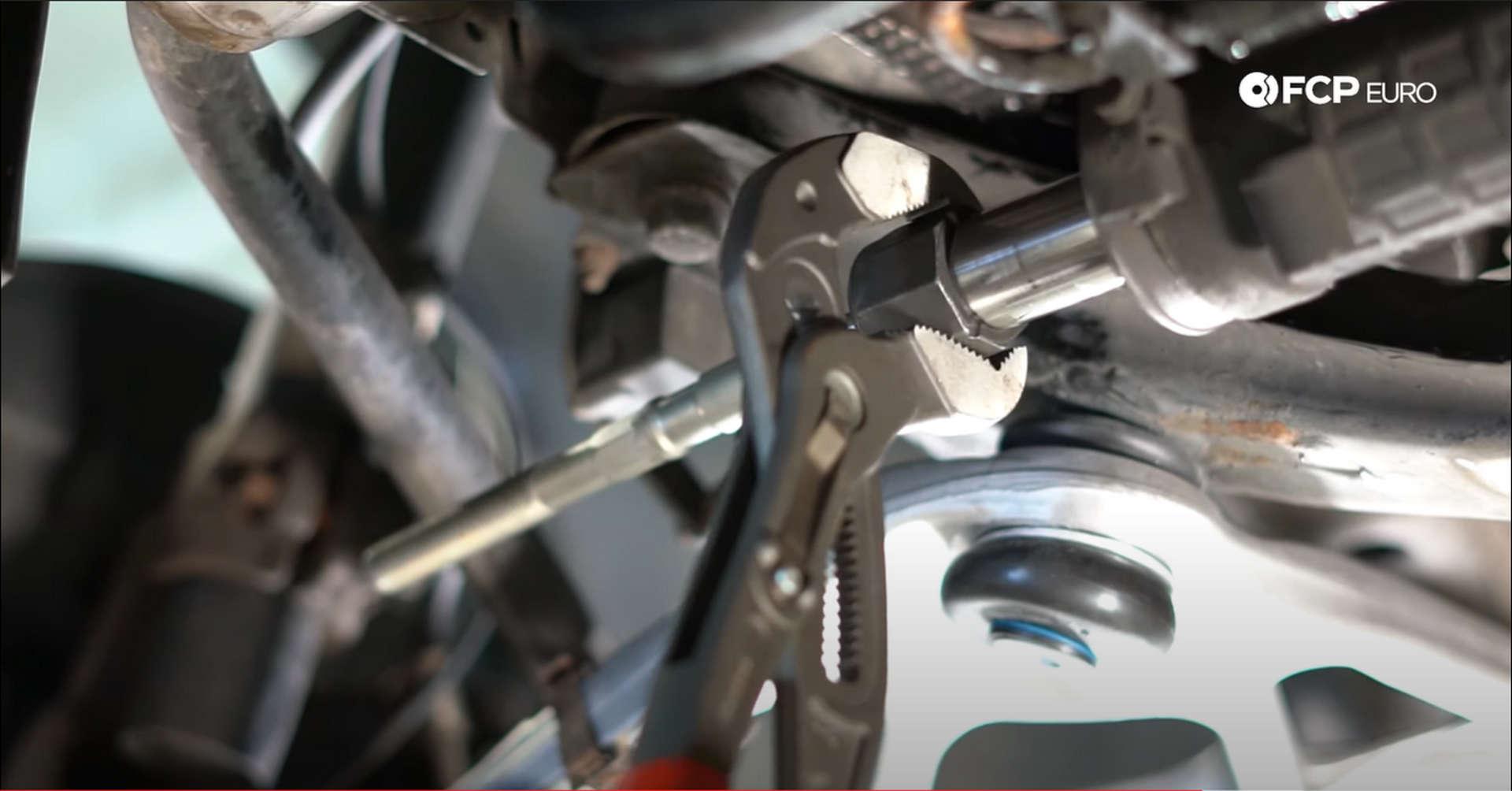 DIY BMW Front Suspension Refresh tightening the inner tie rod