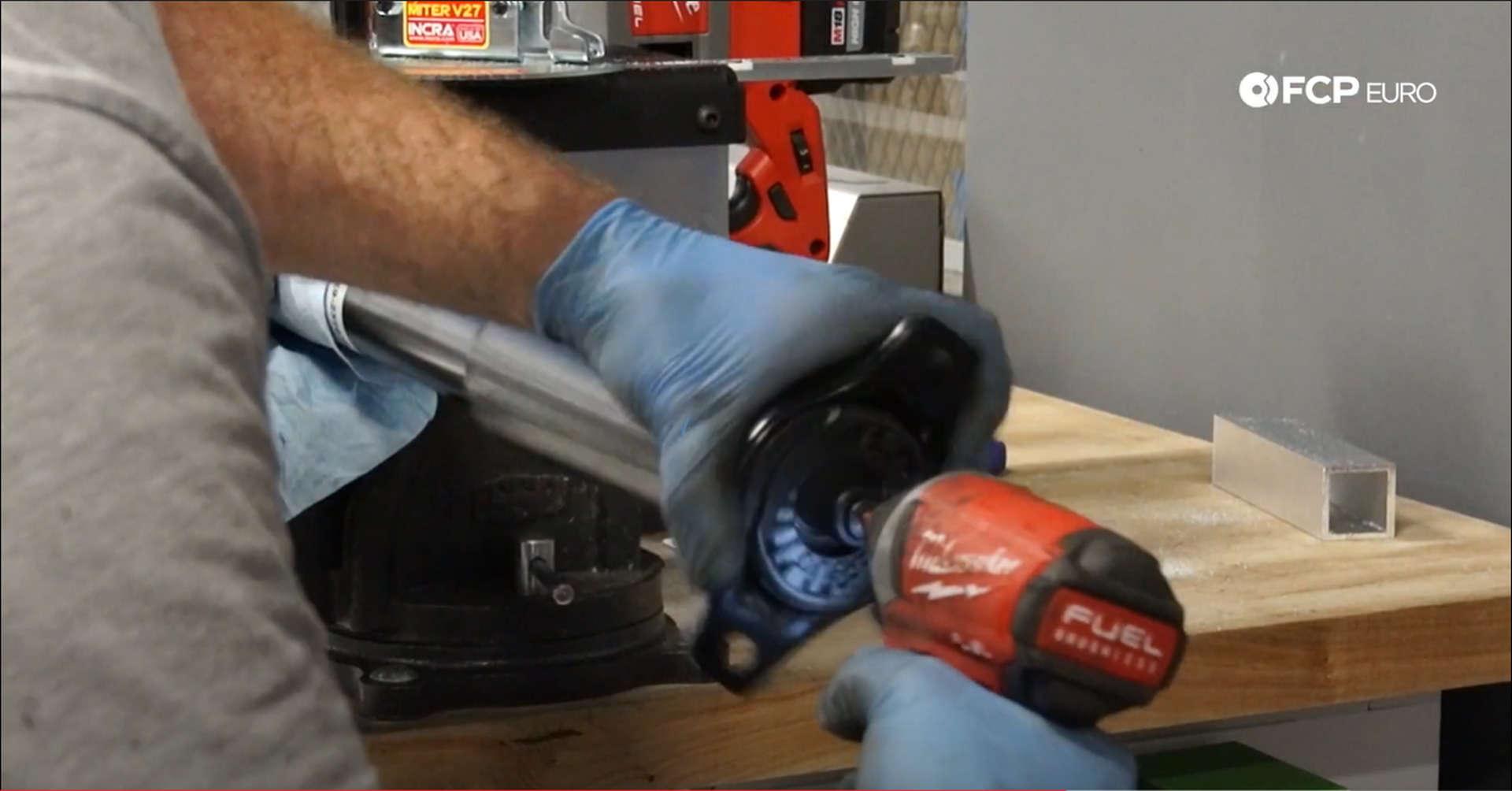 DIY Volvo Rear Shocks installing shock mount nut]
