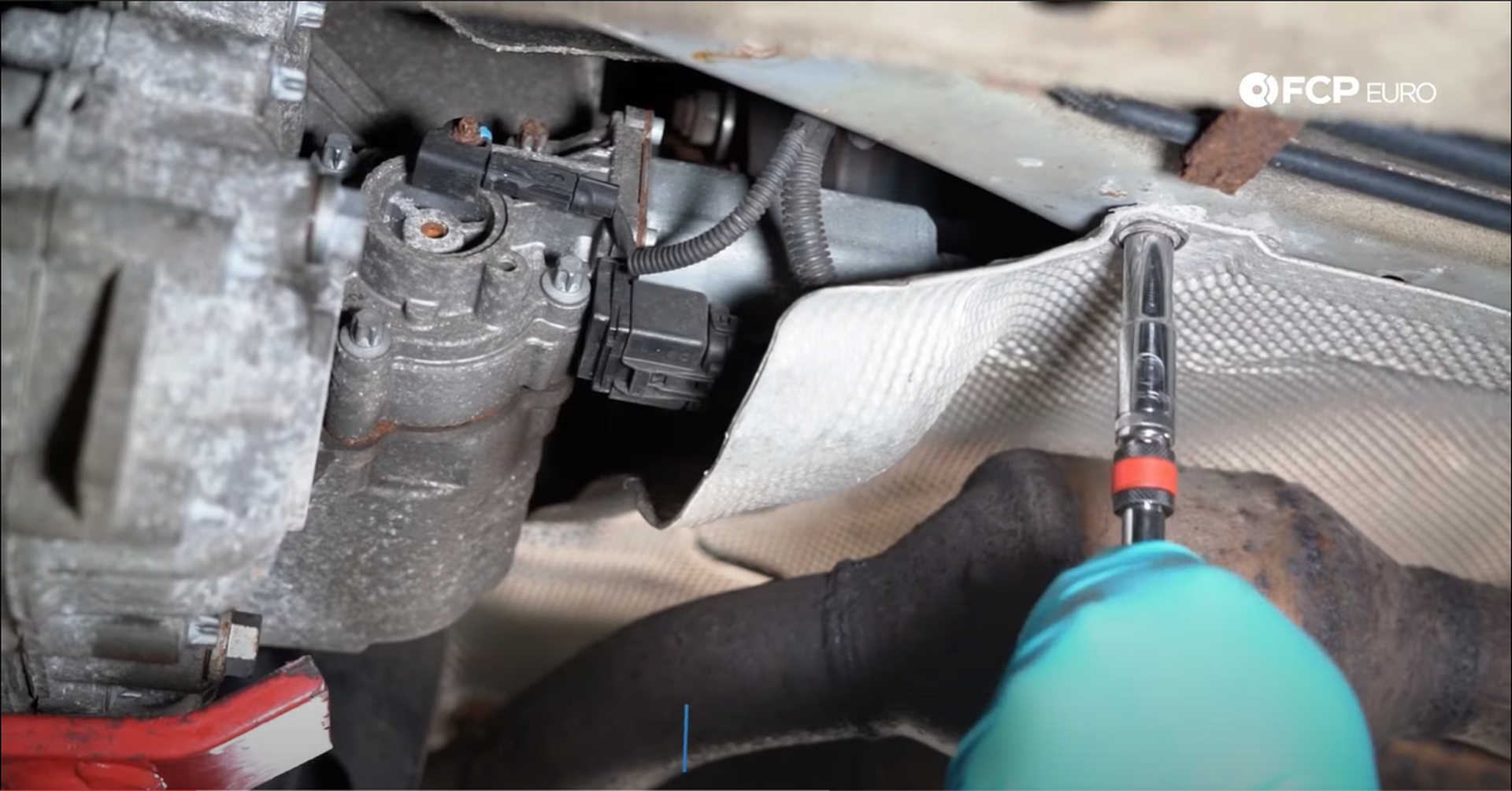 DIY BMW X3 Transfer Case Actuator removing the heat shield bolt