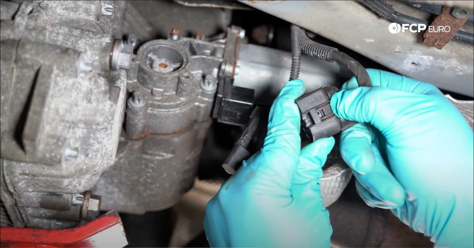 DIY BMW X3 Transfer Case Actuator unplugging the transfer case electrical connection