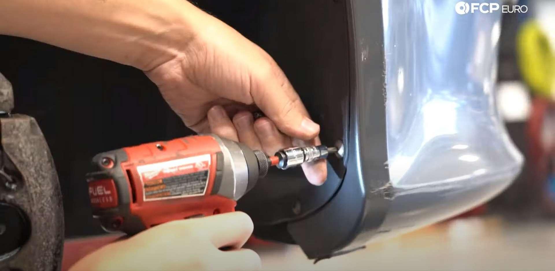 DIY Volvo Alternator and Serpentine Belt Replacement removing the fender liner fasteners
