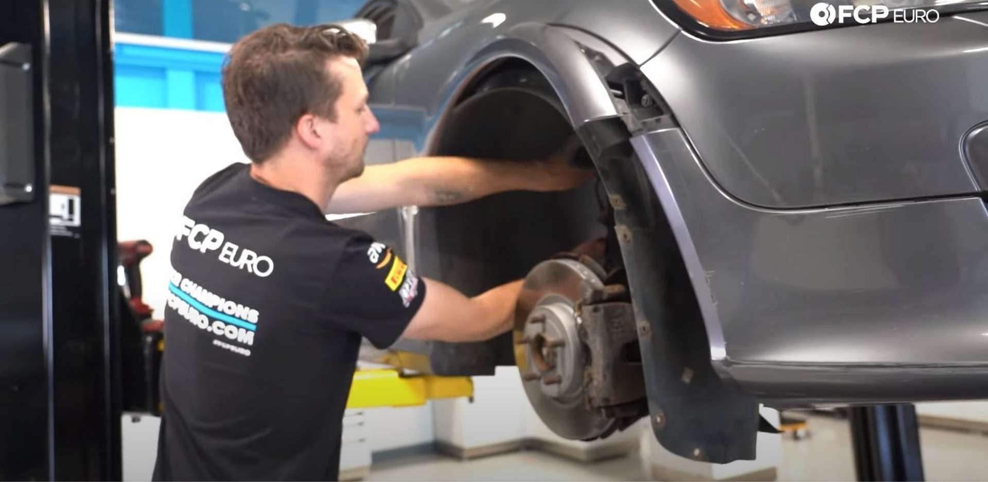 DIY Volvo Alternator and Serpentine Belt Replacement removing the fender liner