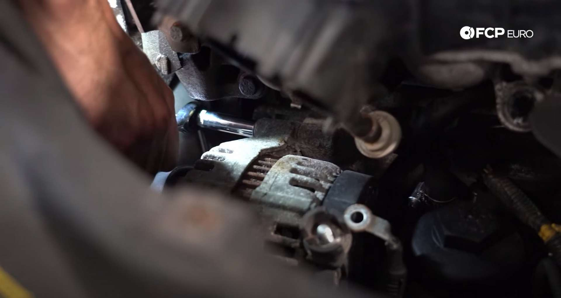 DIY Volvo Alternator and Serpentine Belt Replacement removing the alternator mounting bolts