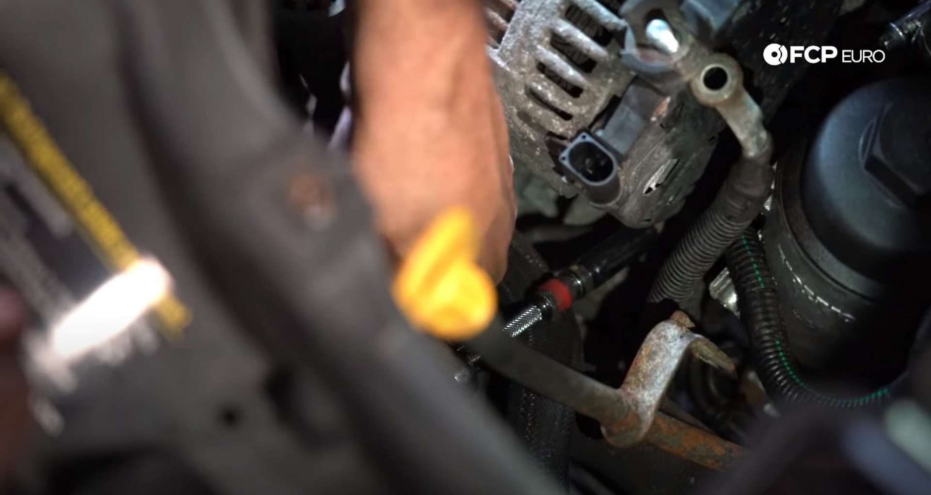 DIY Volvo Alternator and Serpentine Belt Replacement removing the bottom alternator mounting bolt