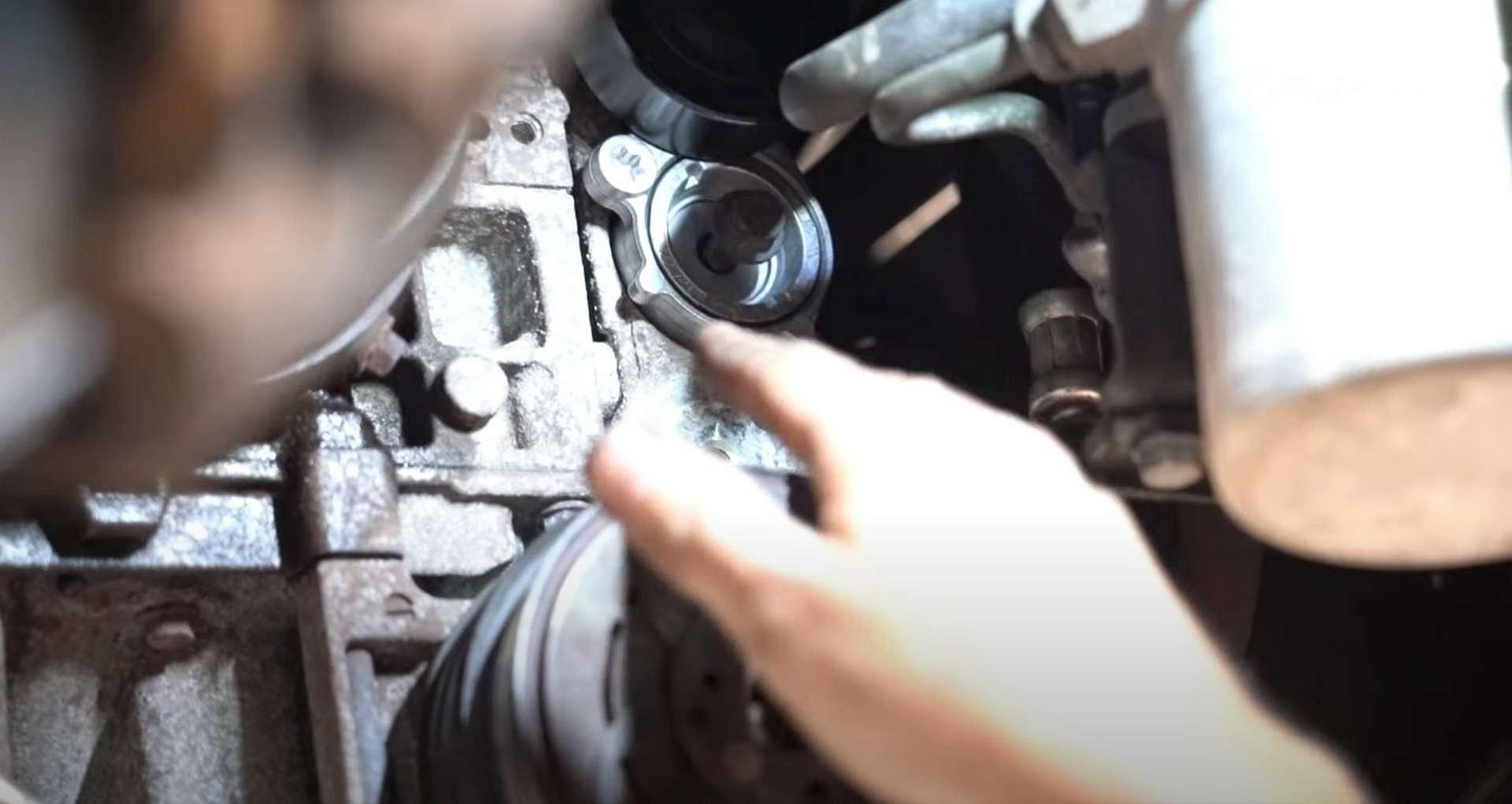 DIY Volvo Alternator and Serpentine Belt Replacement reinstalling the inner tensioner bolt