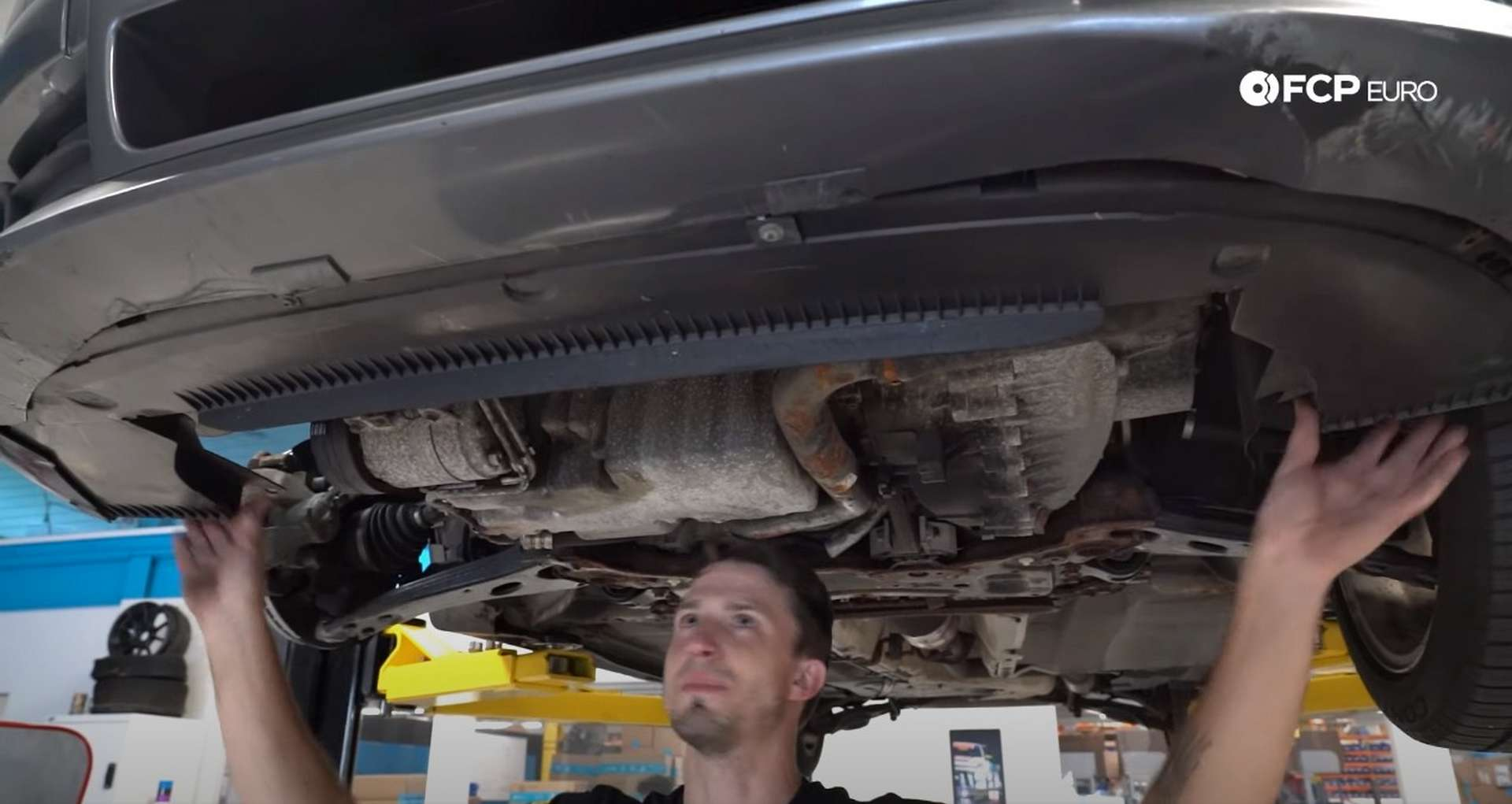DIY Volvo Alternator and Serpentine Belt Replacement installing the lower air spoiler