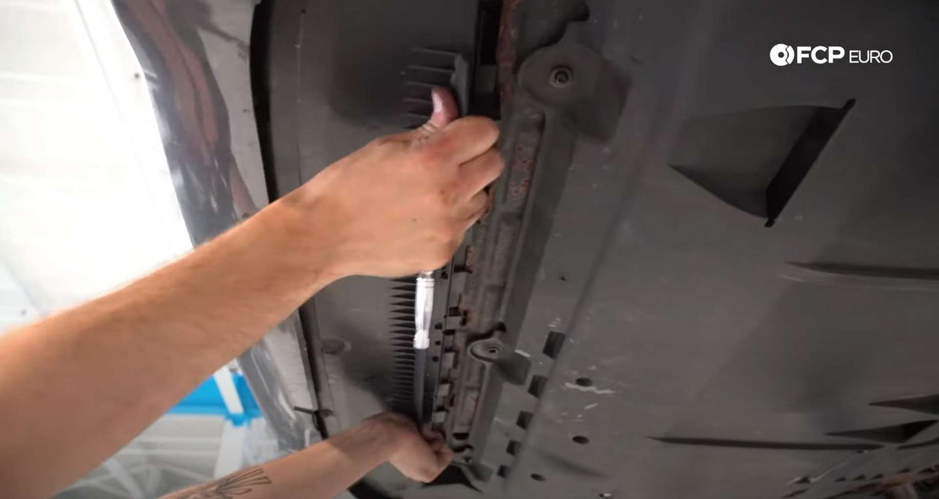 DIY Volvo Alternator and Serpentine Belt Replacement installing the belly pan