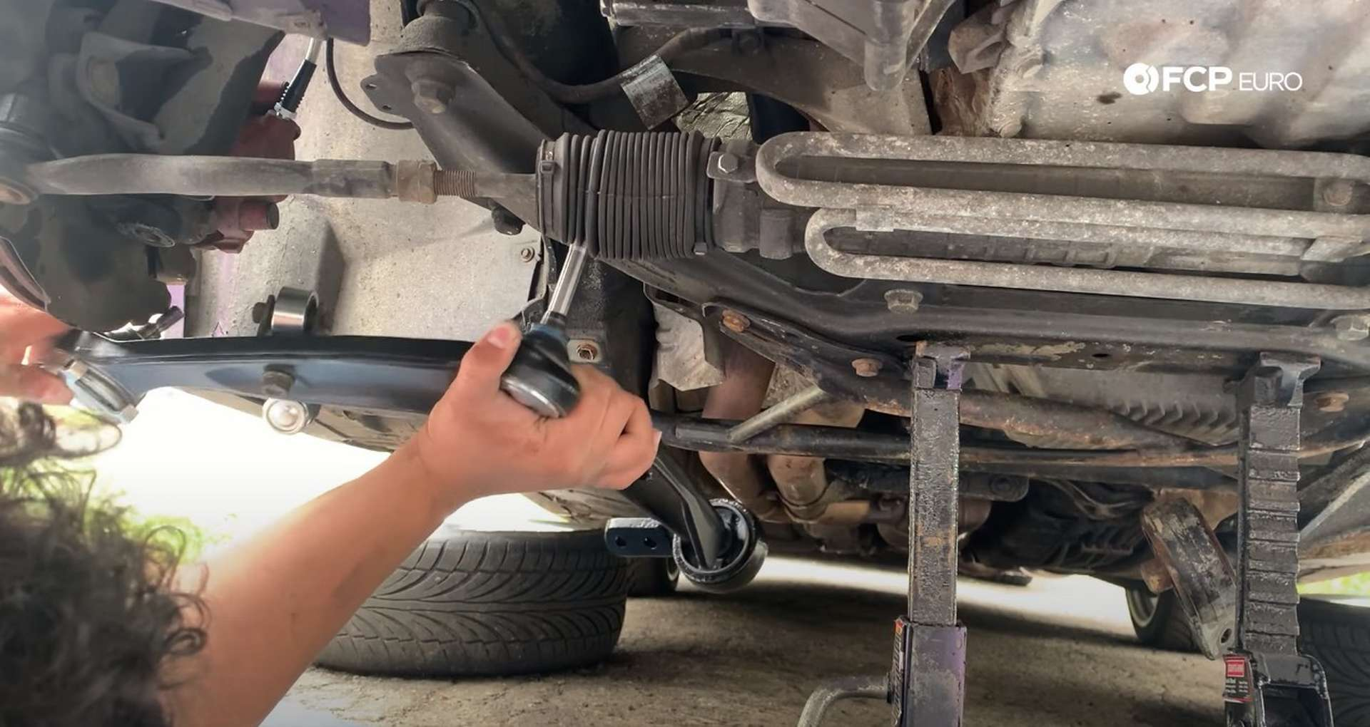 DIY BMW E36 Control Arm and Bushings installing the control arm into the subframe