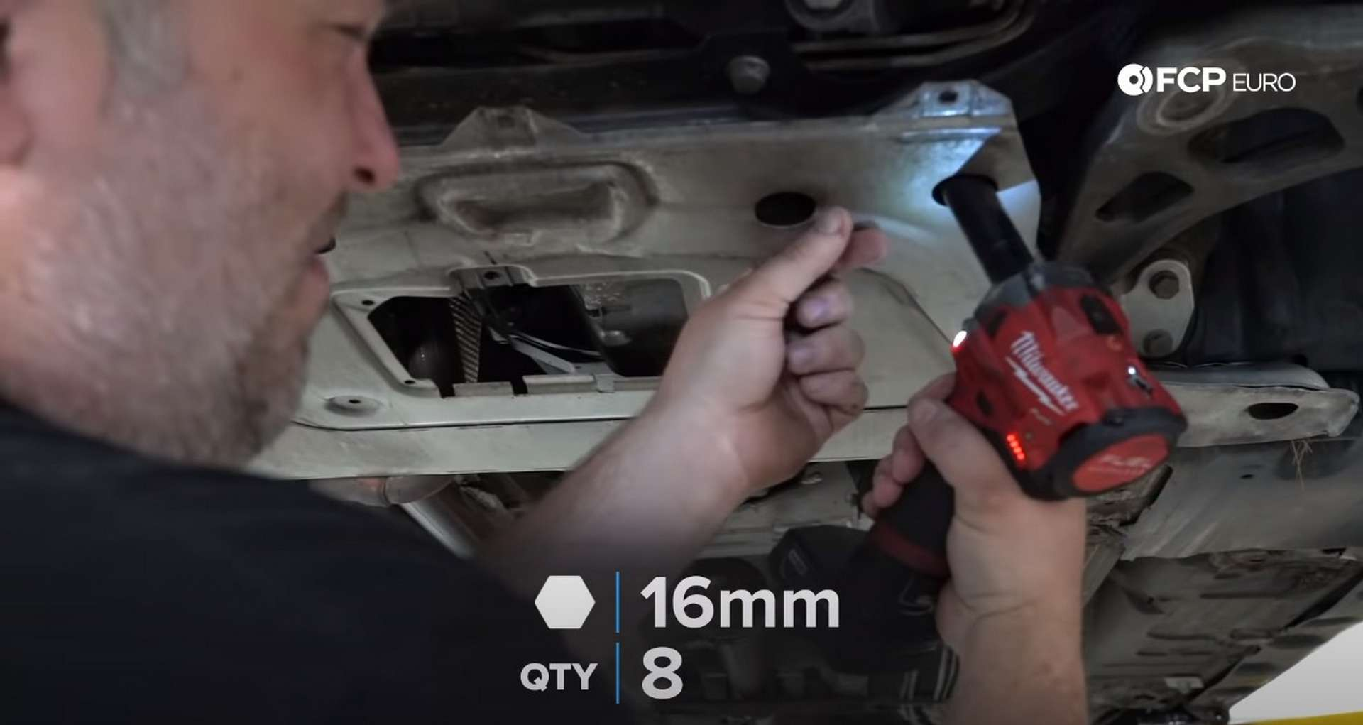 DIY BMW E46 Clutch Replacement removing the subframe reinforcement plate
