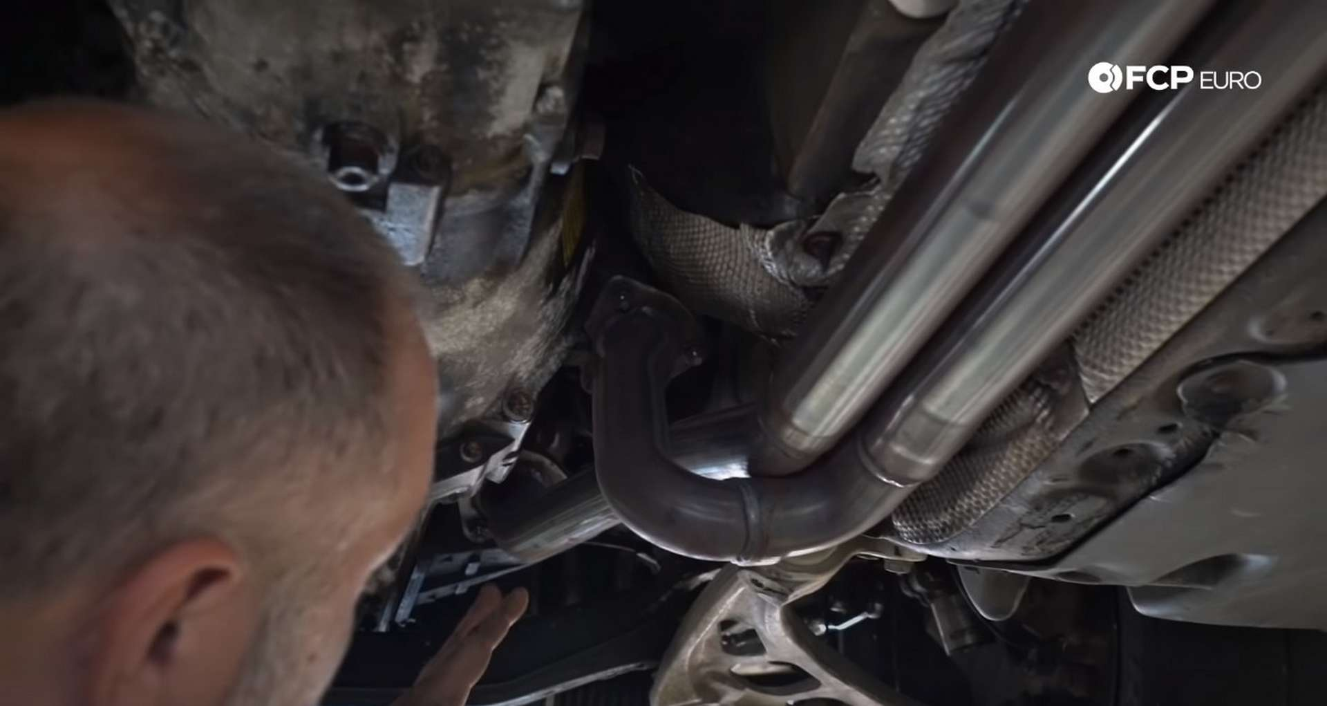 DIY BMW E46 Clutch Replacement removing the exhaust manifold nuts