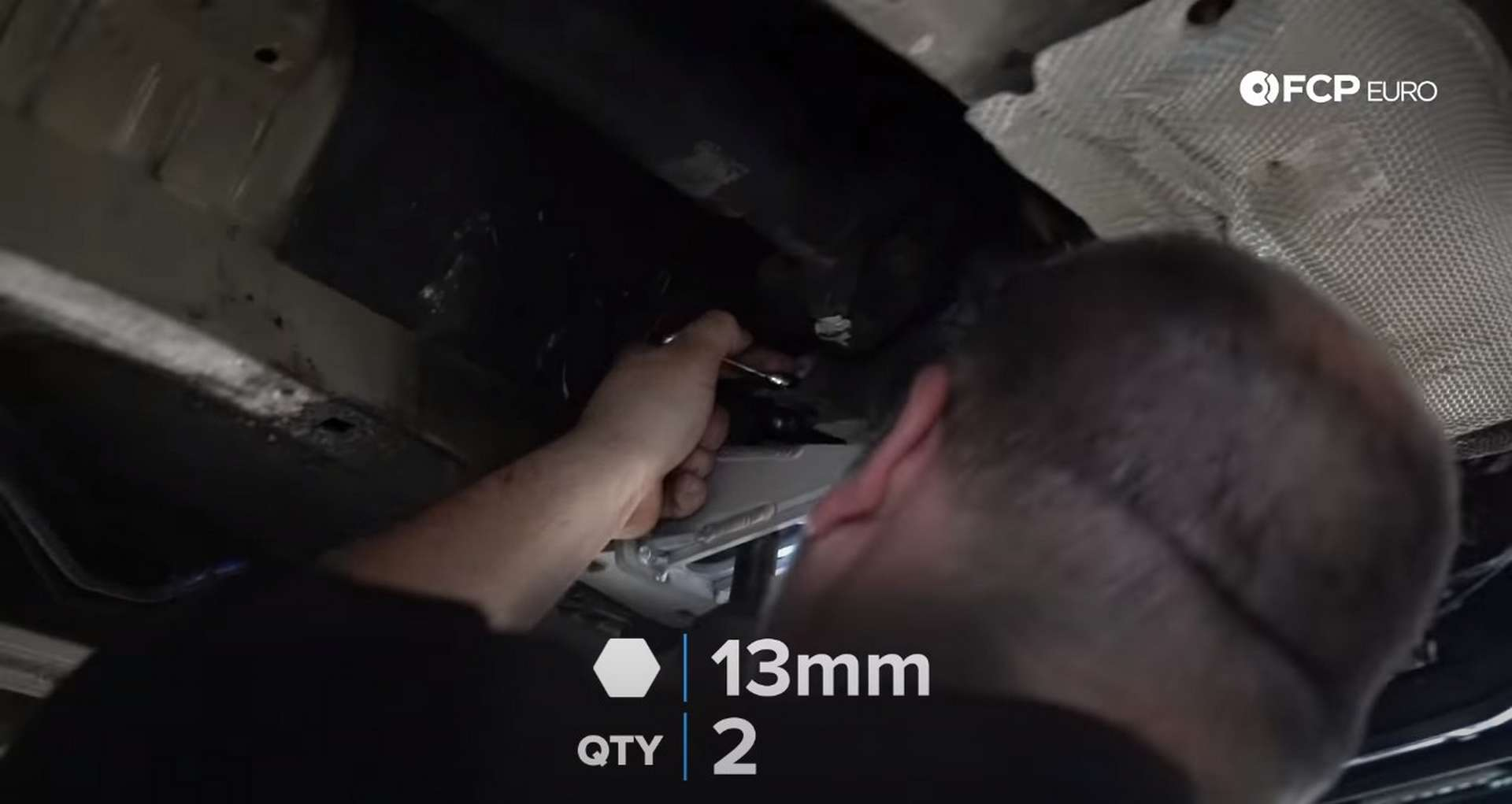 DIY BMW E46 Clutch Replacement separating the transmission from the crossmemeber
