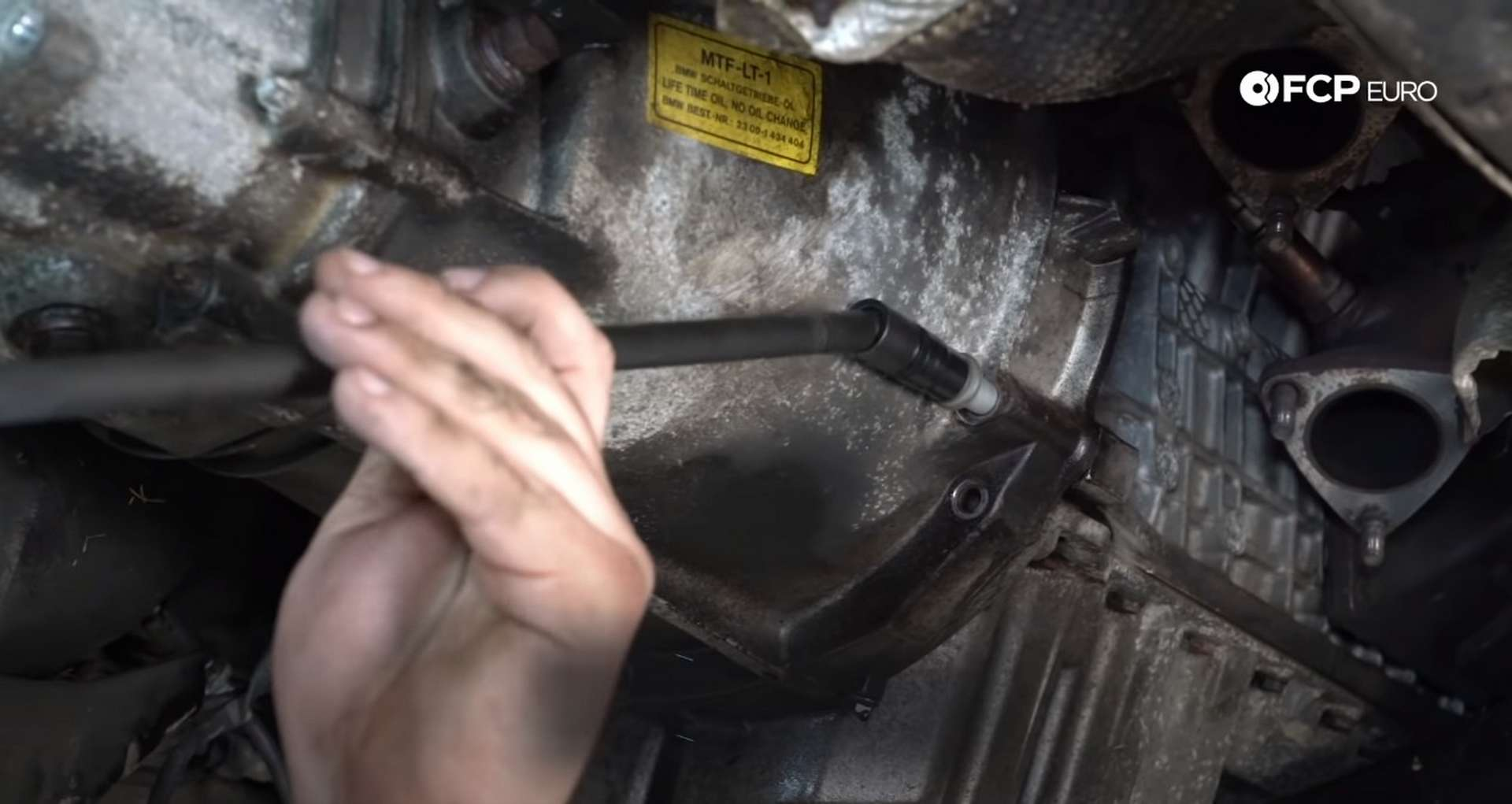 DIY BMW E46 Clutch Replacement removing the bell housing bolts