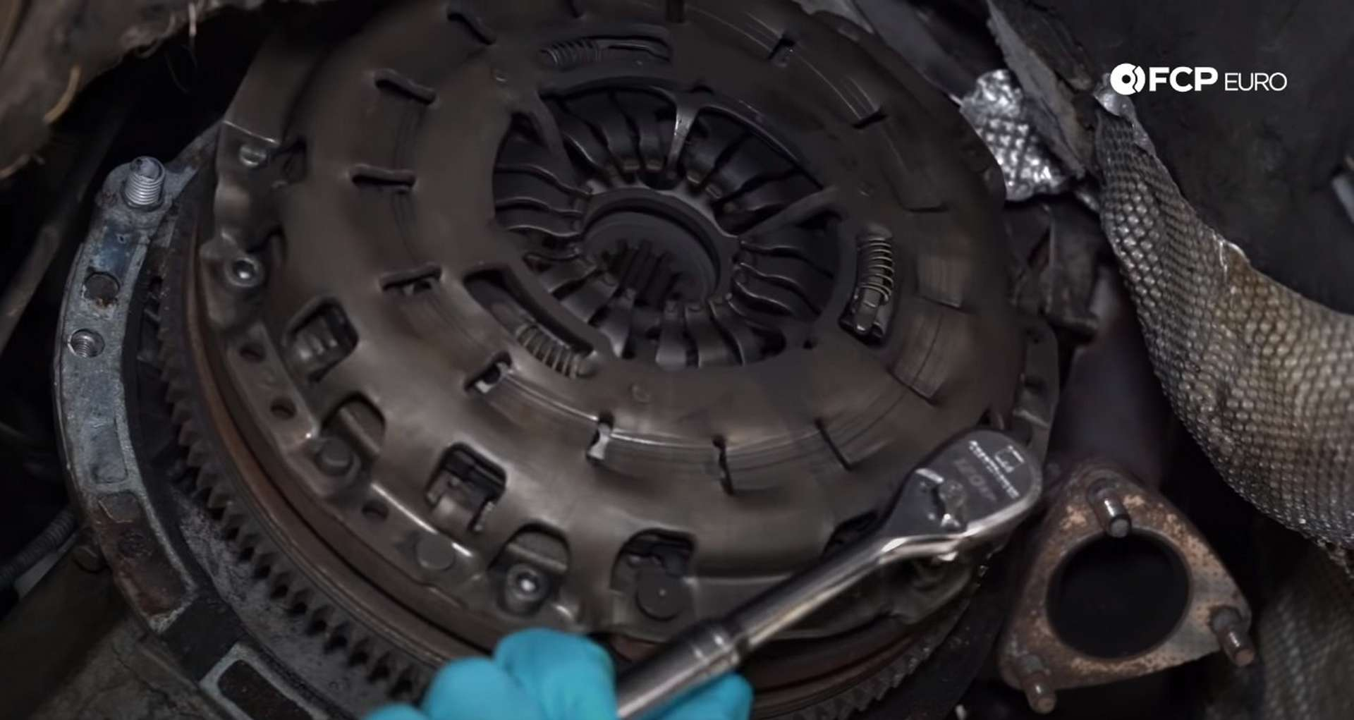 DIY BMW E46 Clutch Replacement removing the pressure plate bolts