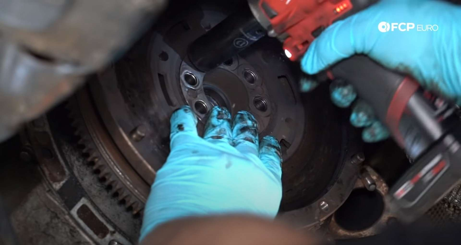 DIY BMW E46 Clutch Replacement removing the flywheel bolts