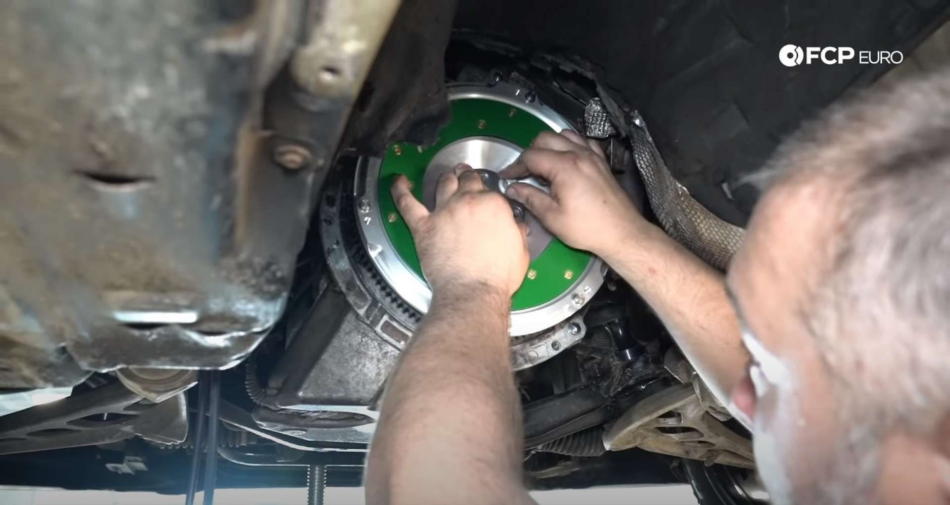 DIY BMW E46 Clutch Replacement installing the flywheel