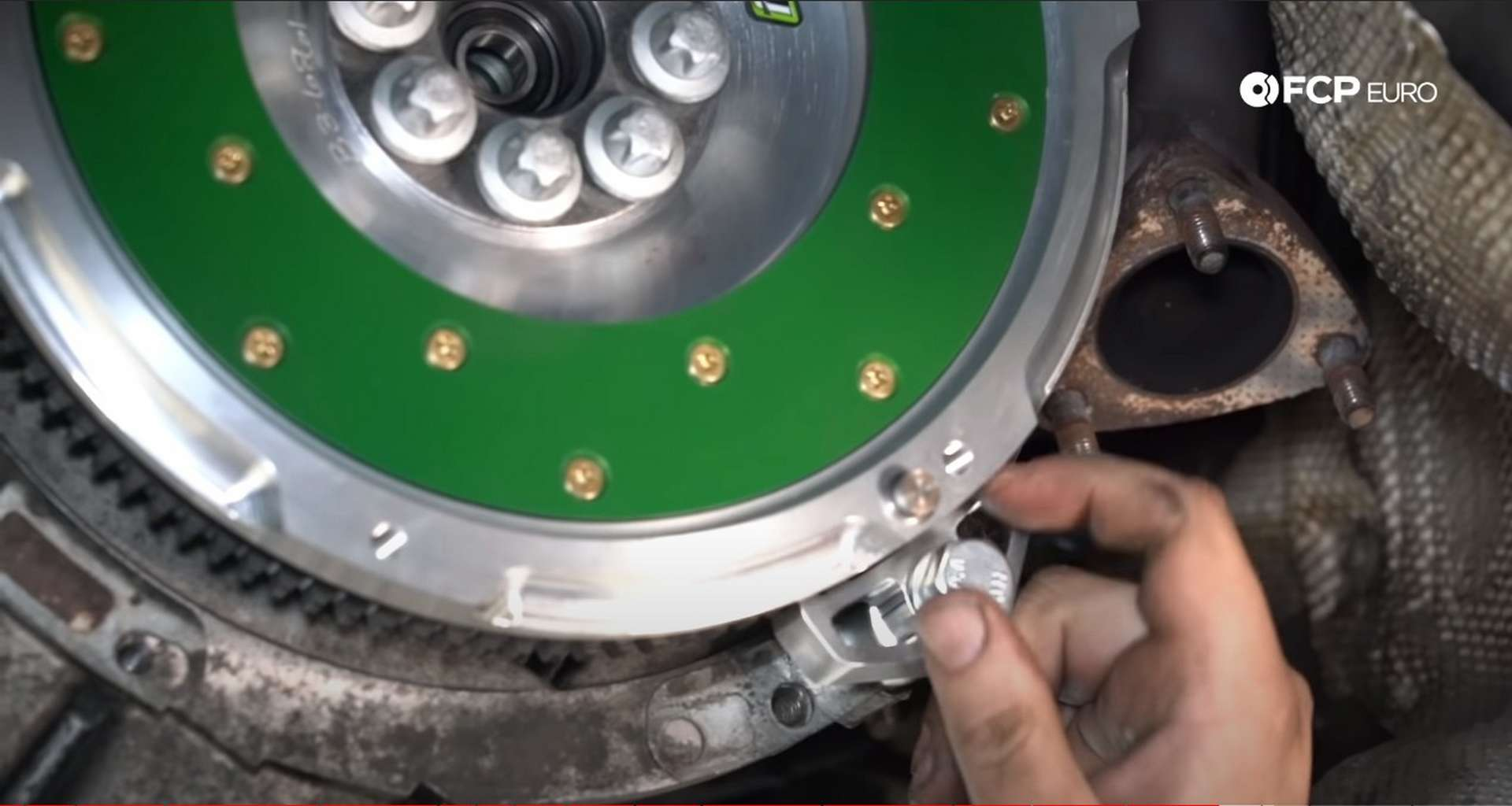 DIY BMW E46 Clutch Replacement installing the flywheel locking tool