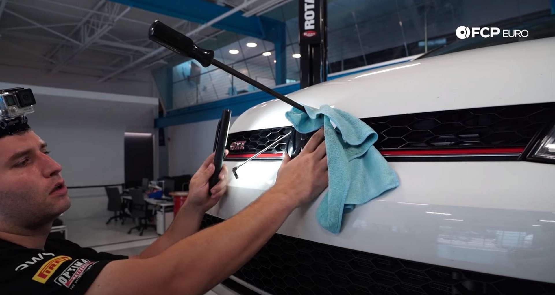 DIY VW GTI Hood Release prying the hood open