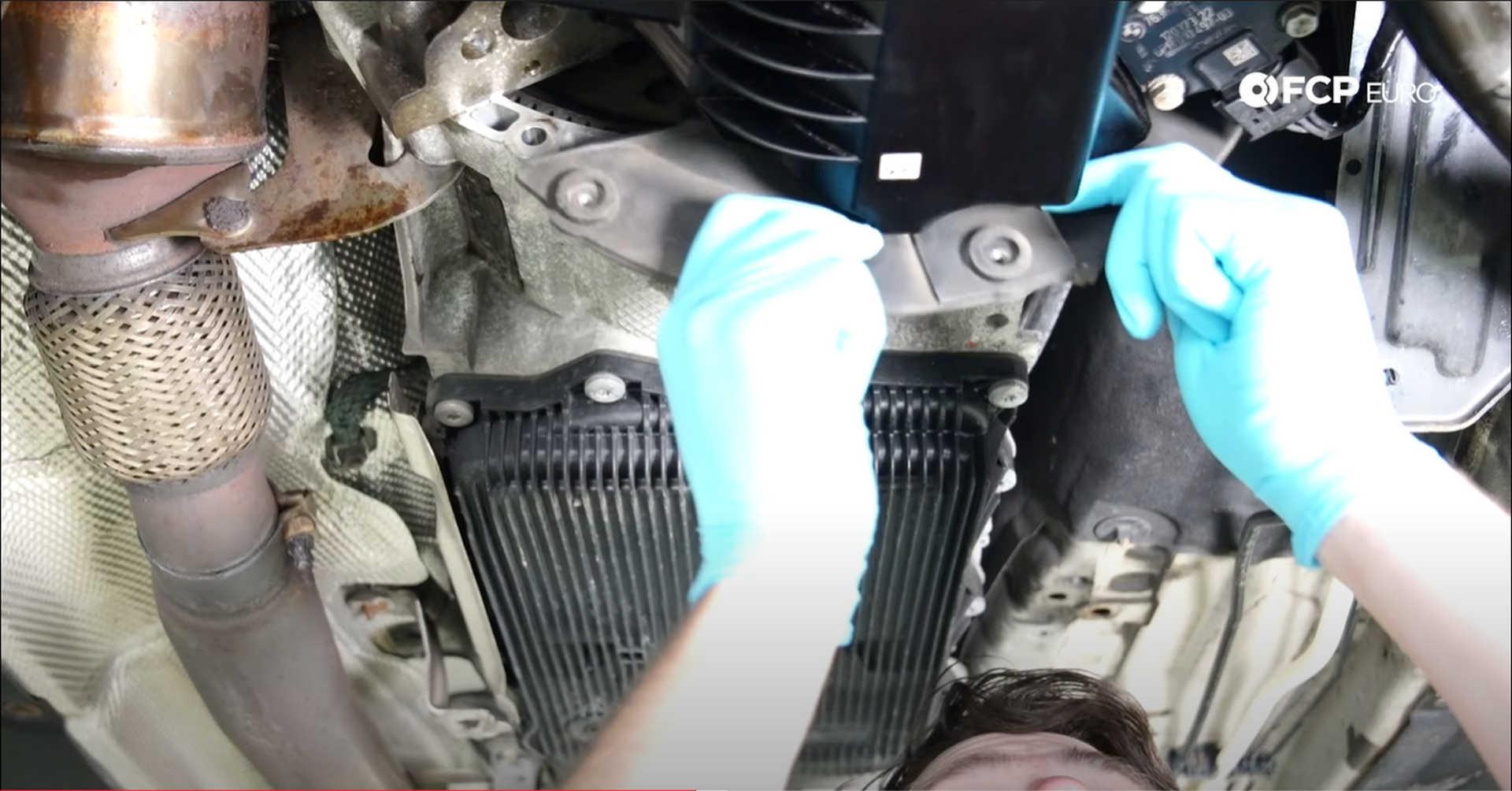 DIY BMW N20 Timing Chain refitting the transmission dust shield