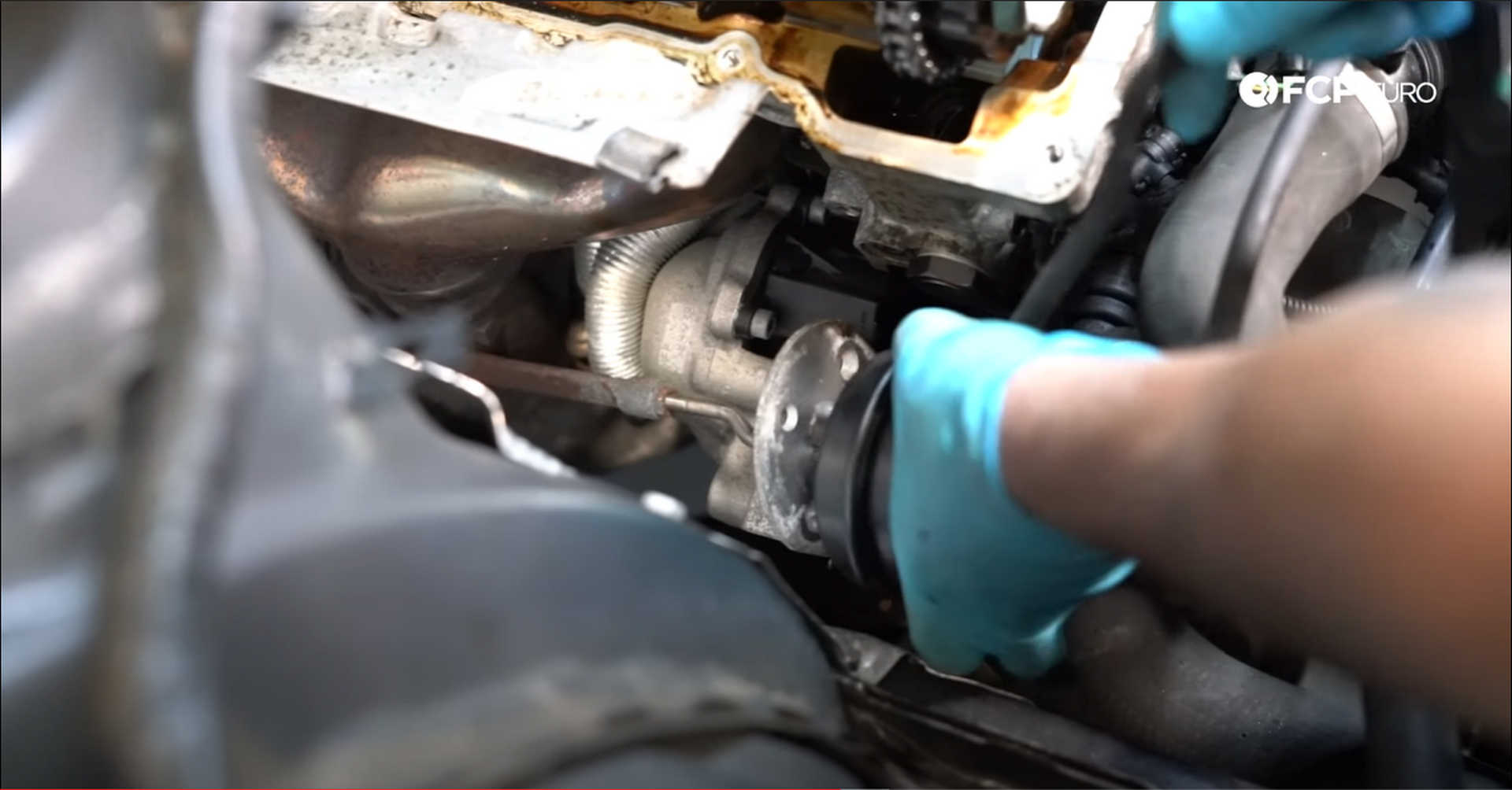 DIY BMW N20 Timing Chain fitting the wastegate actuator into its bracket