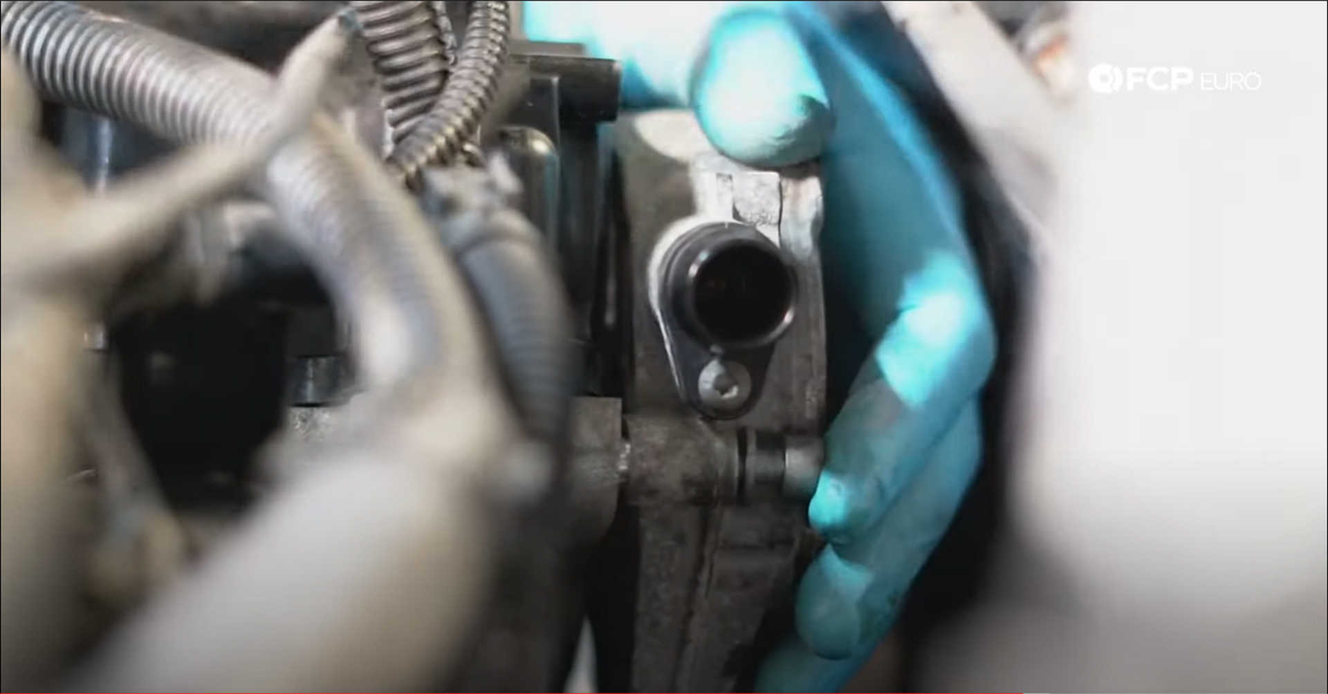 DIY BMW N20 Timing Chain installing the vacuum pump bolts