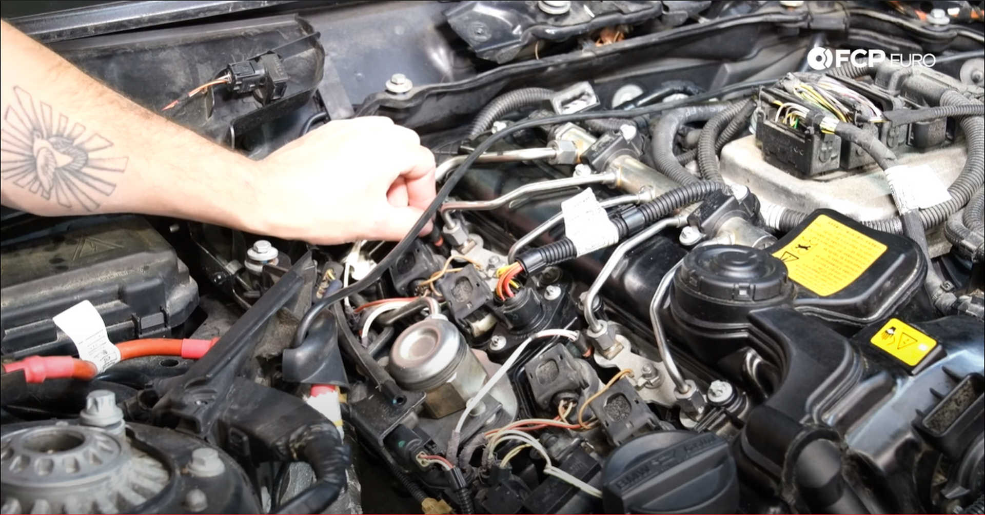 DIY BMW N20 Timing Chain plugging in the fuel injectors