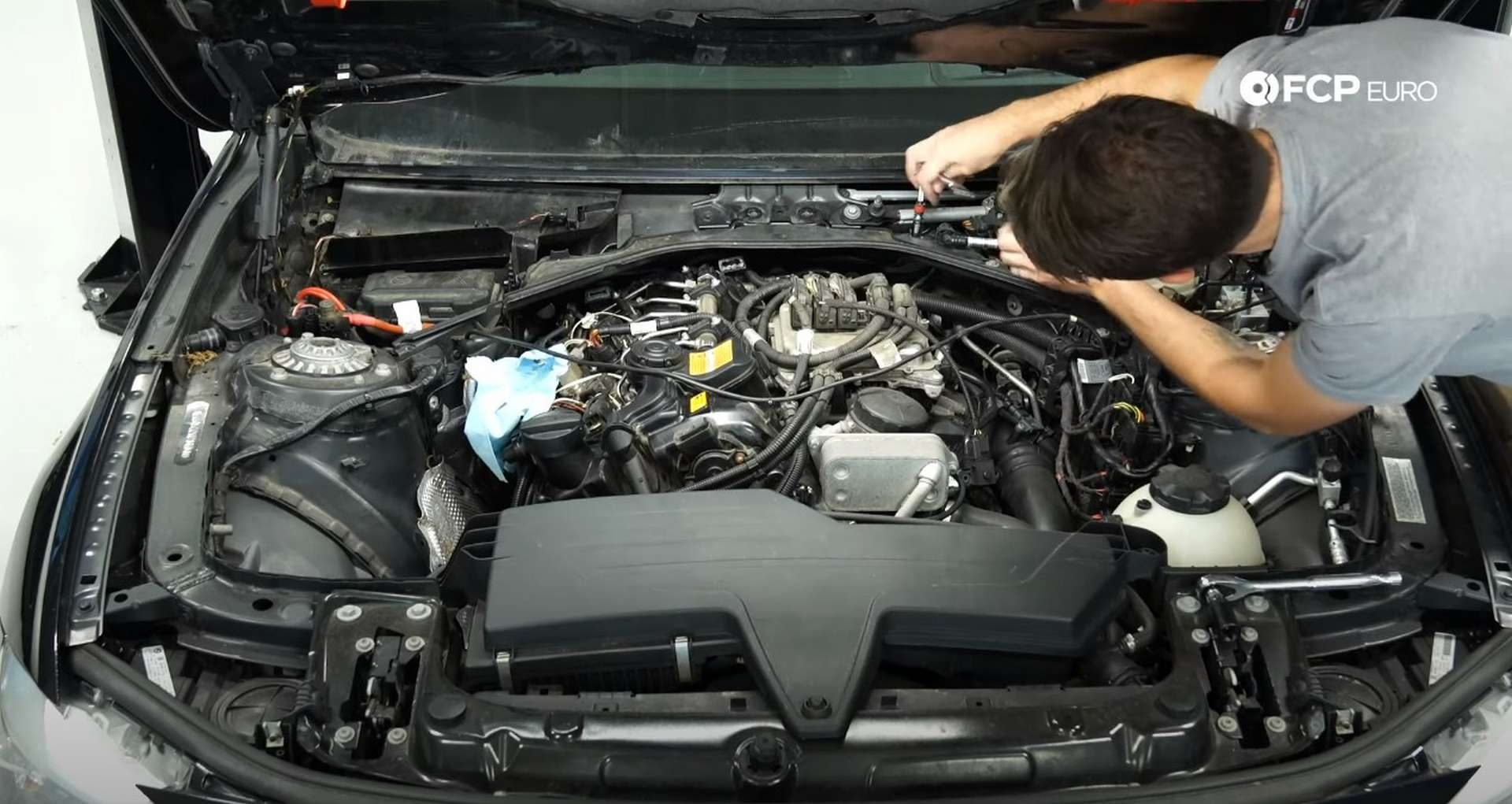 DIY BMW N20 Vacuum Pump removing the engine cover