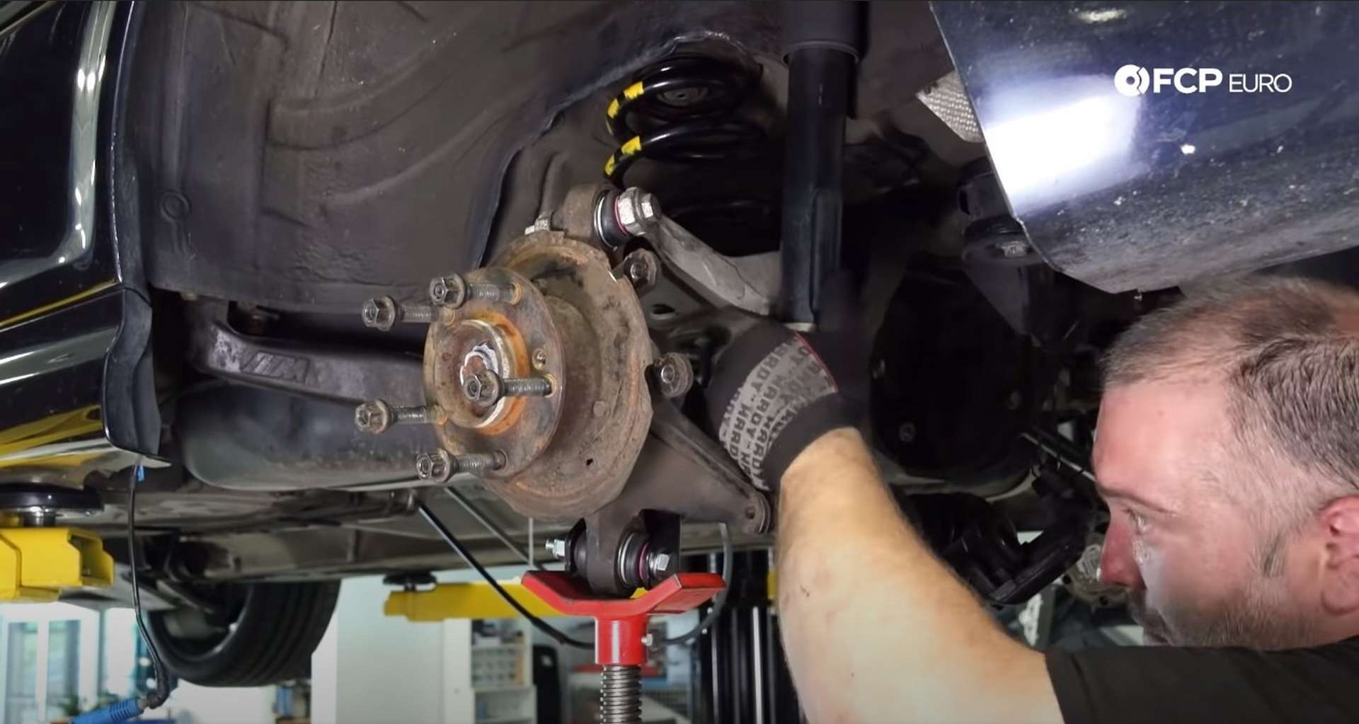 DIY E46 BMW M3 Rear Subframe Refresh Part 3 raising the knuckle to line up the lower shock bolt