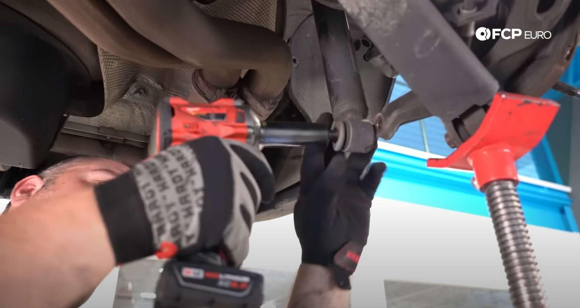 DIY E46 BMW M3 Rear Subframe Refresh Part 3 installing the lower shock bolt