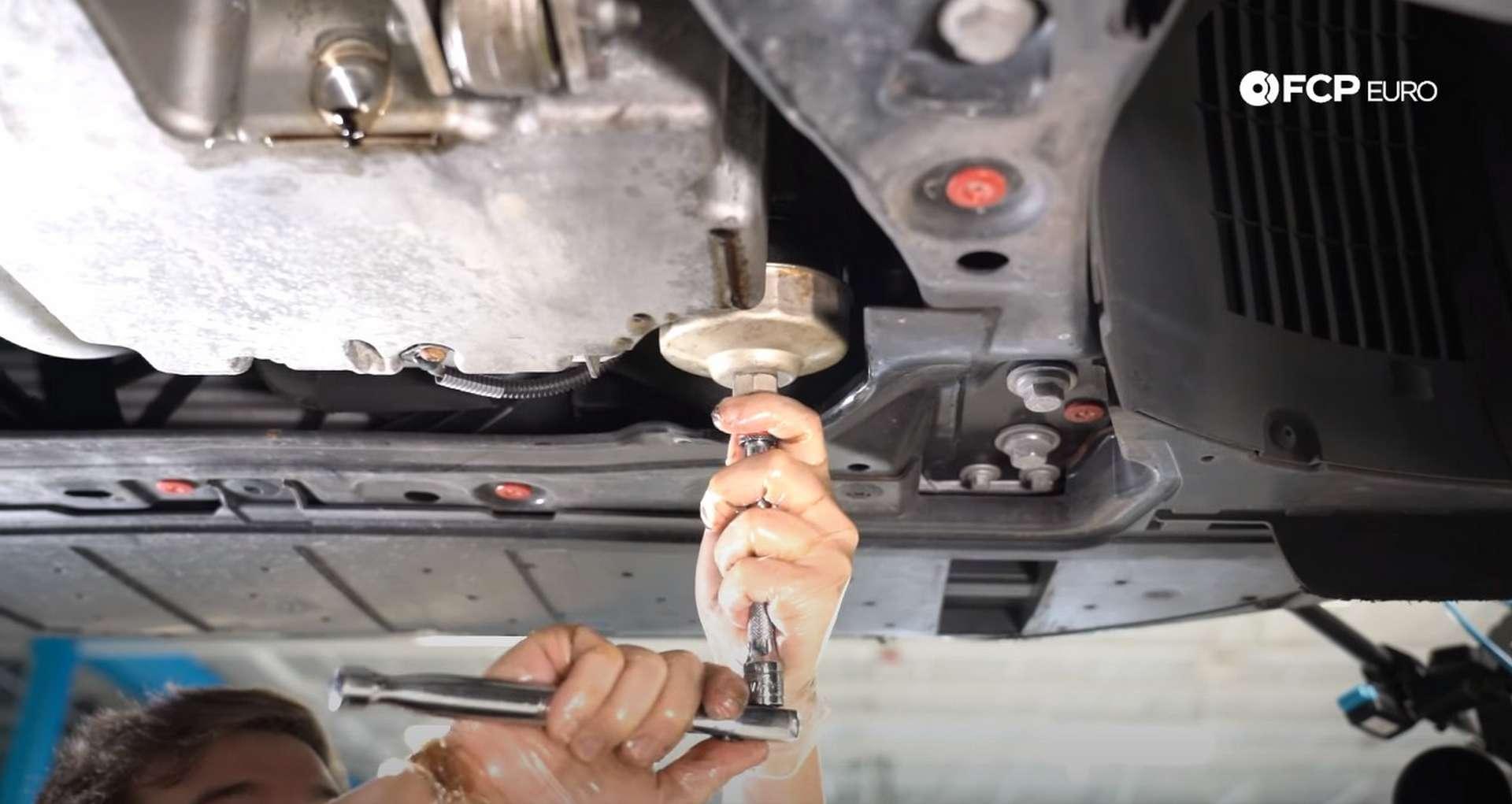 DIY Volvo SPA Oil Change installing the oil filter housing cap