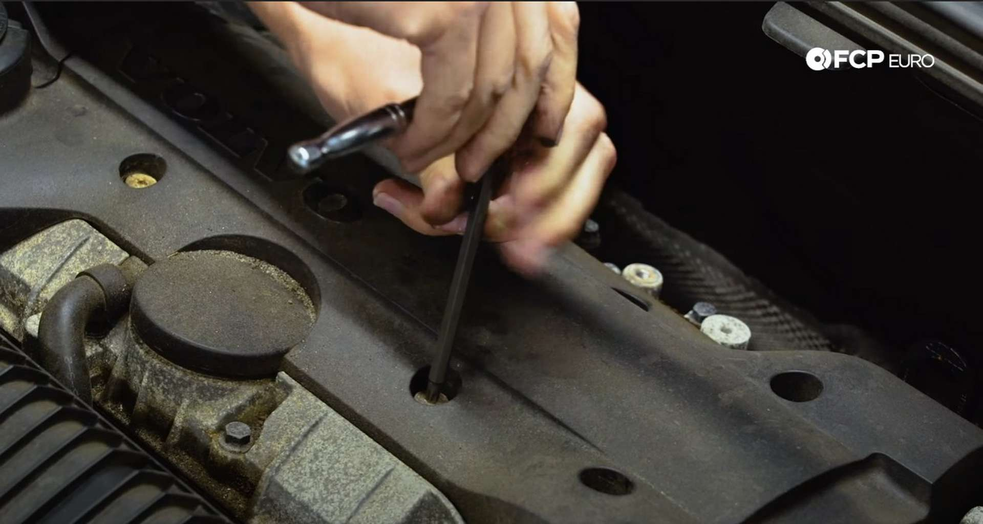 DIY Volvo Spark Plug and Ignition Coil Replacement removing the ignition coil cover