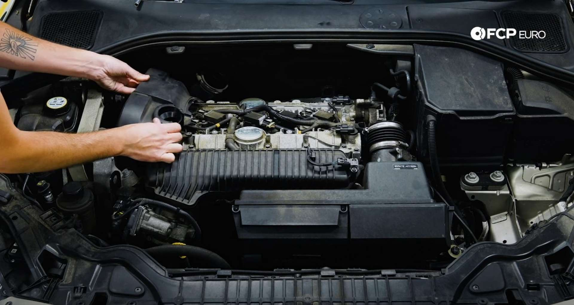 DIY Volvo Spark Plug and Ignition Coil Replacement removing the timing cover