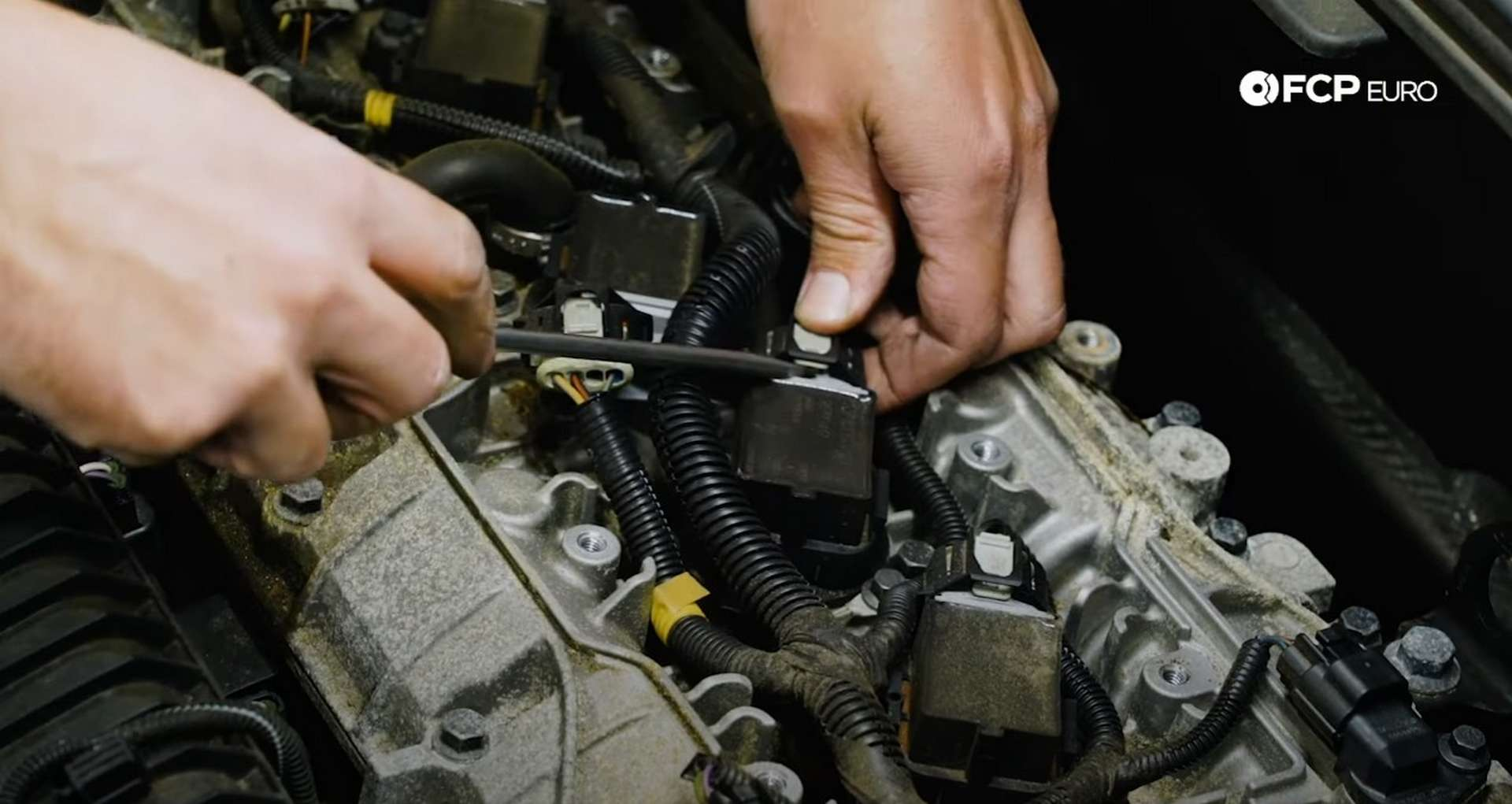 DIY Volvo Spark Plug and Ignition Coil Replacement unplugging the ignition harness