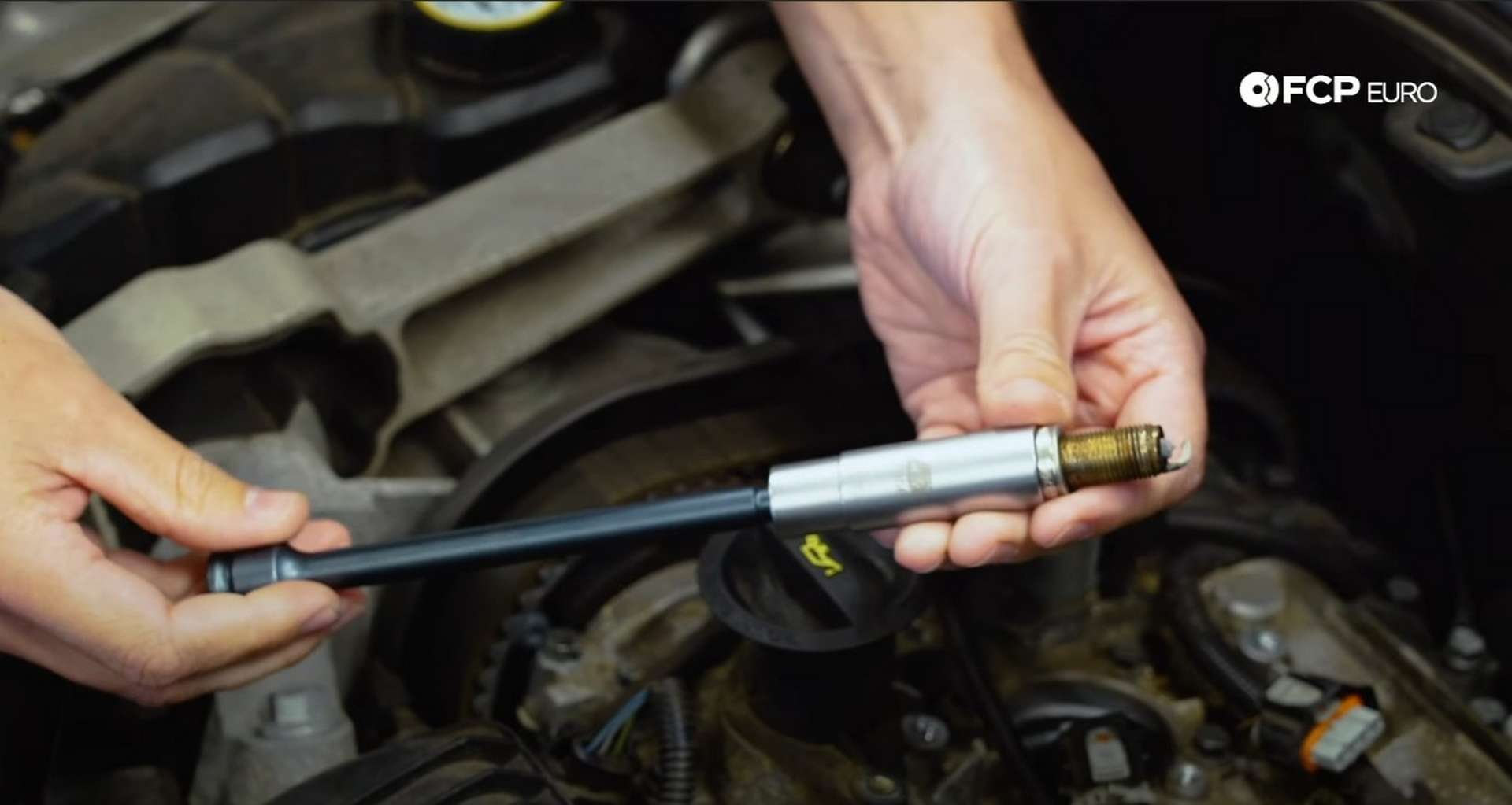 DIY Volvo Spark Plug and Ignition Coil Replacement spark plug removed in the socket
