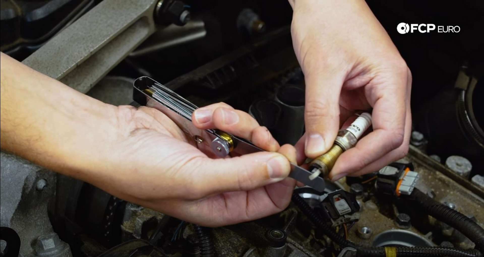 DIY Volvo Spark Plug and Ignition Coil Replacement checking the spark plug gap