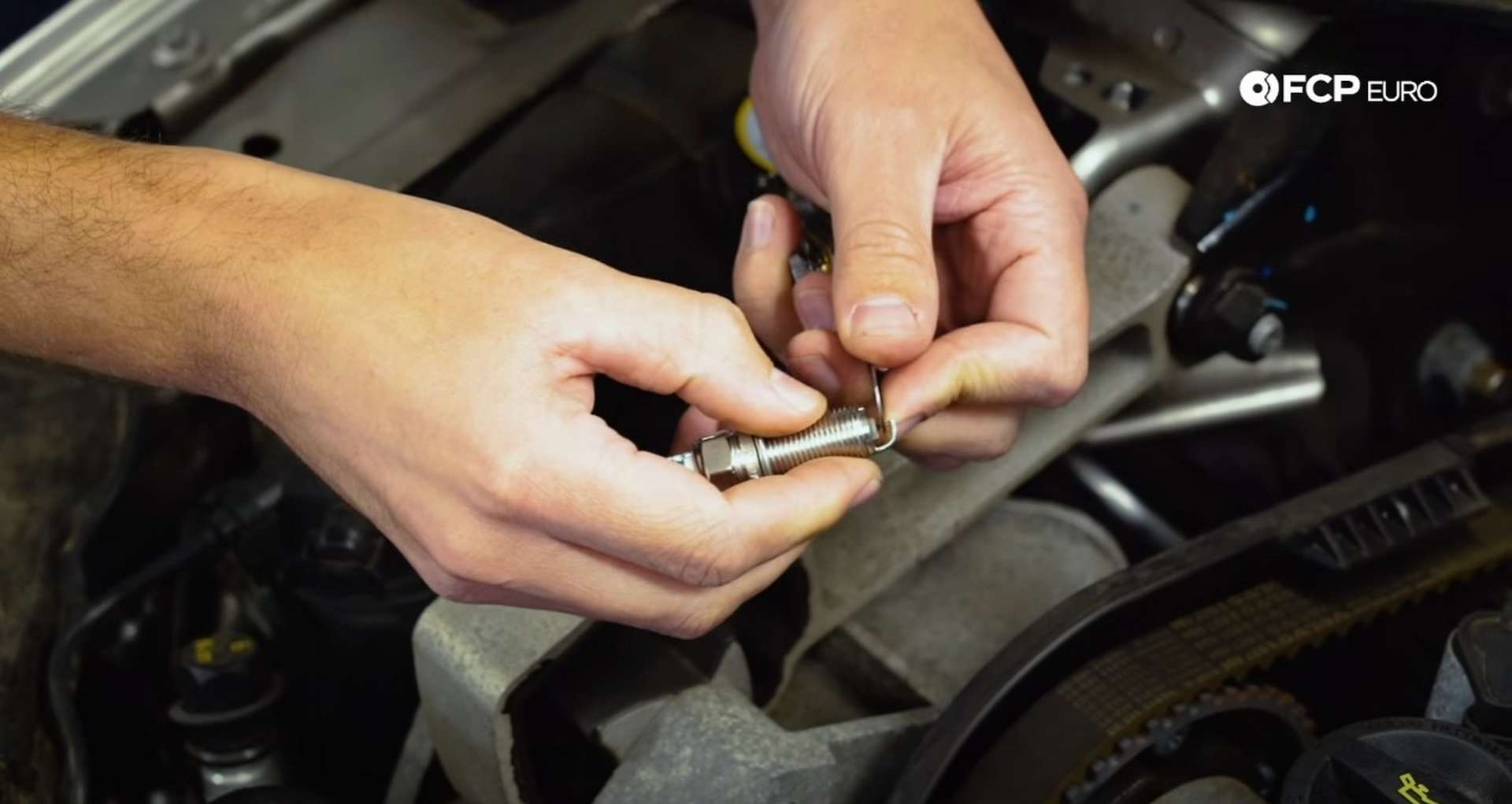 DIY Volvo Spark Plug and Ignition Coil Replacement tightening the spark plug gap