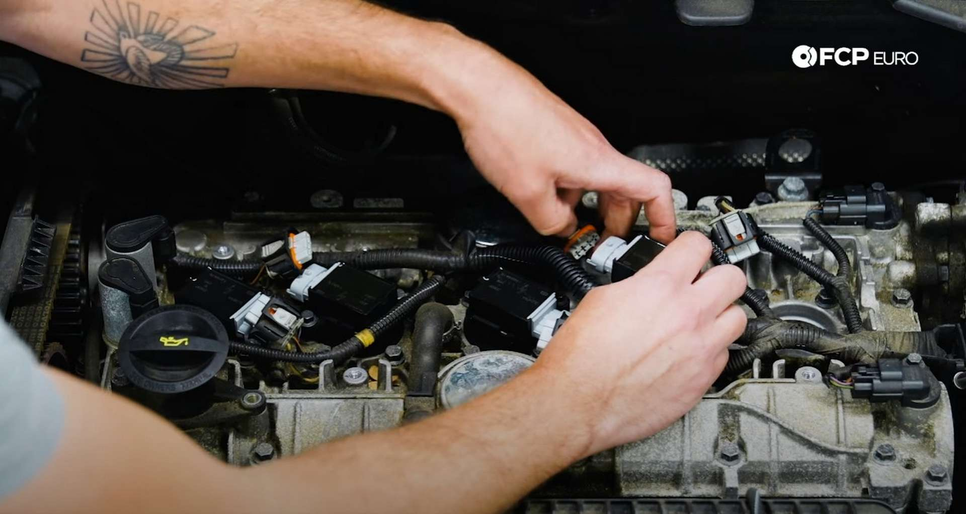 DIY Volvo Spark Plug and Ignition Coil Replacement installing the ignition coil]