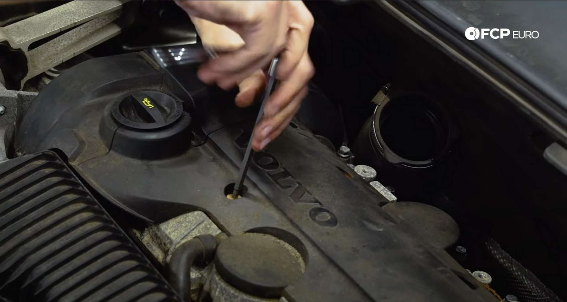 DIY Volvo Spark Plug and Ignition Coil Replacement refitting the ignition coil cover