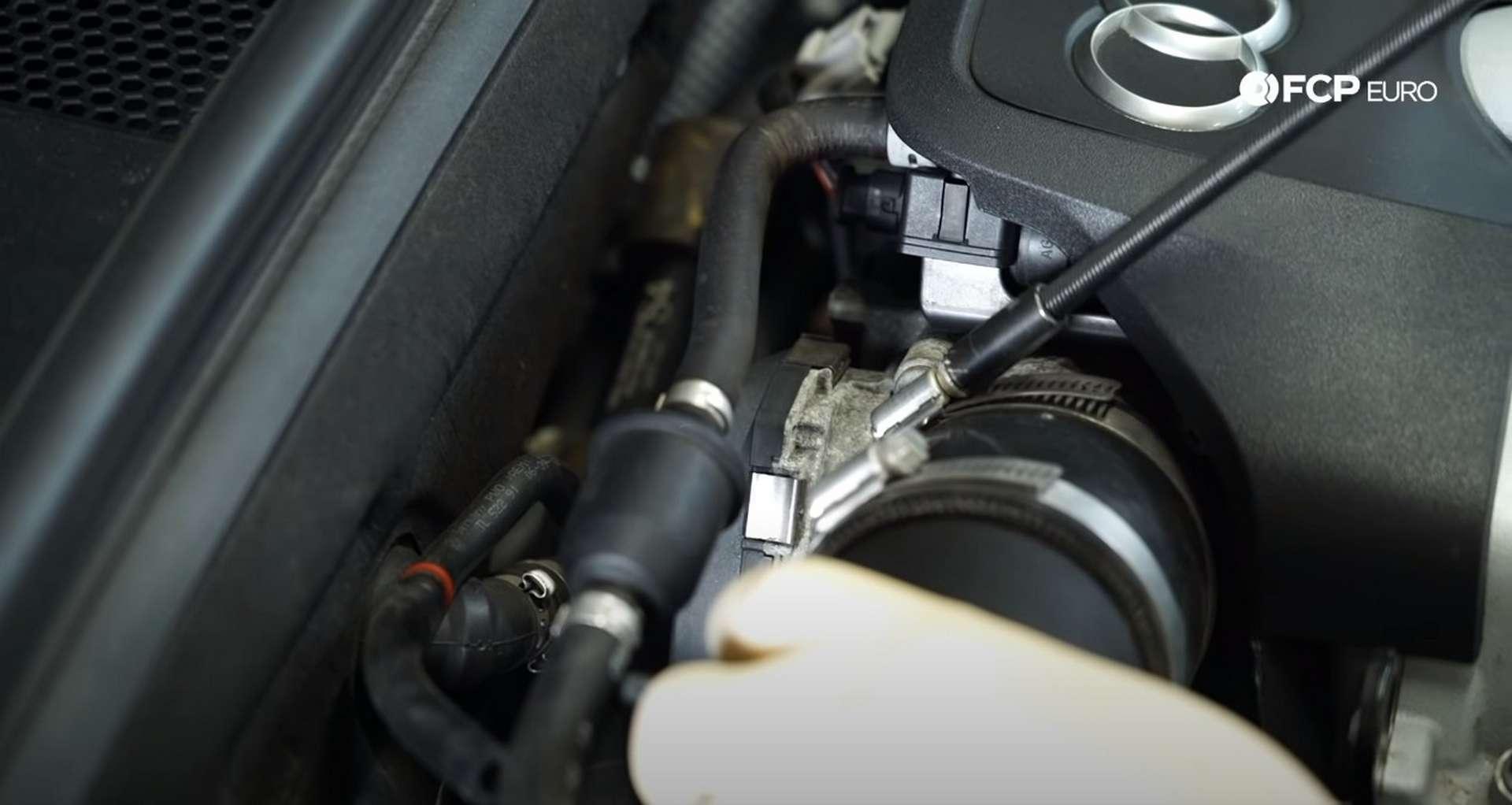DIY Audi 3.0T Supercharger Oil Change loosening the intake hose clamp