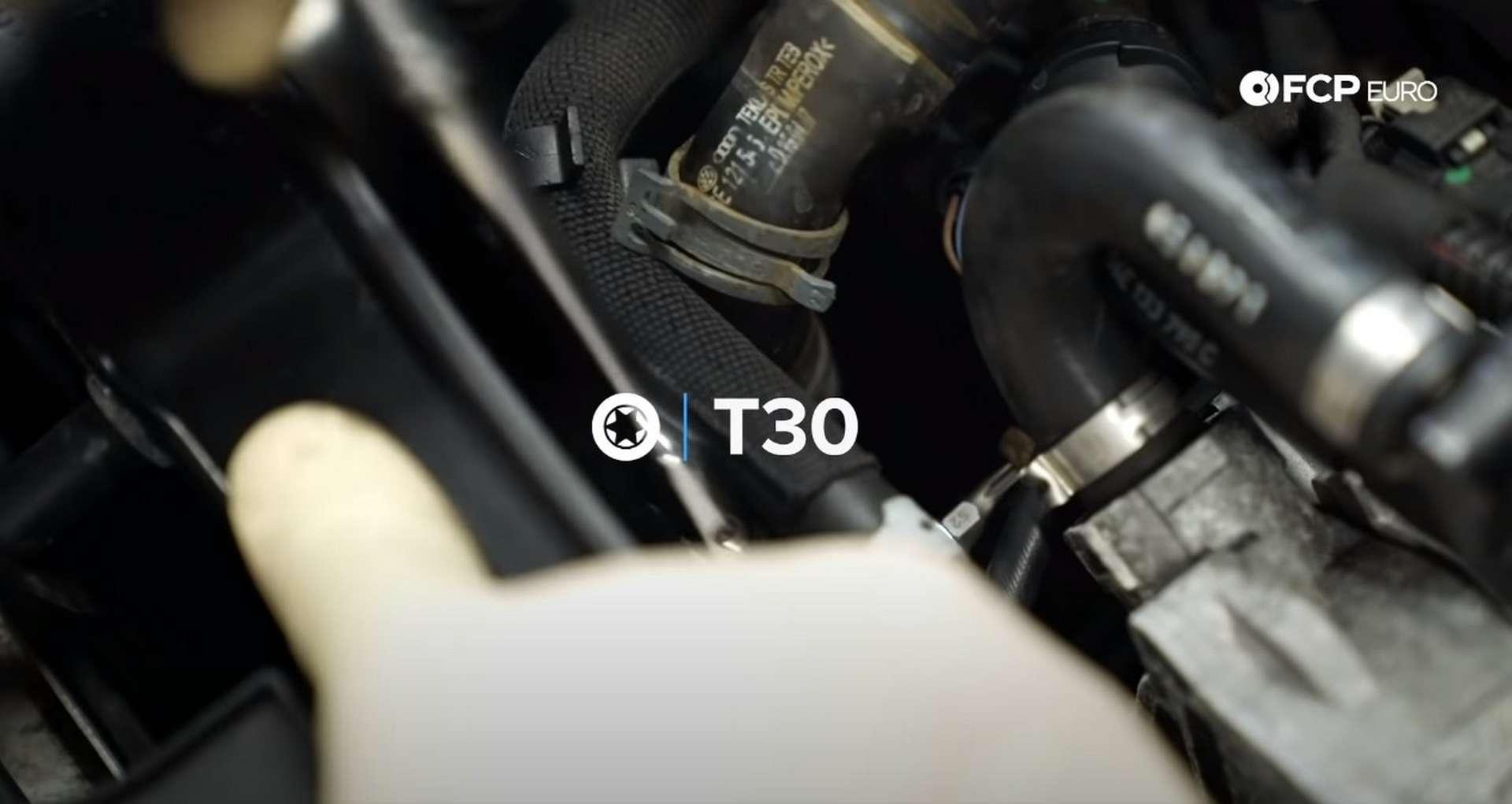DIY Audi 3.0T Supercharger Oil Change removing coolant hose mounting bolt