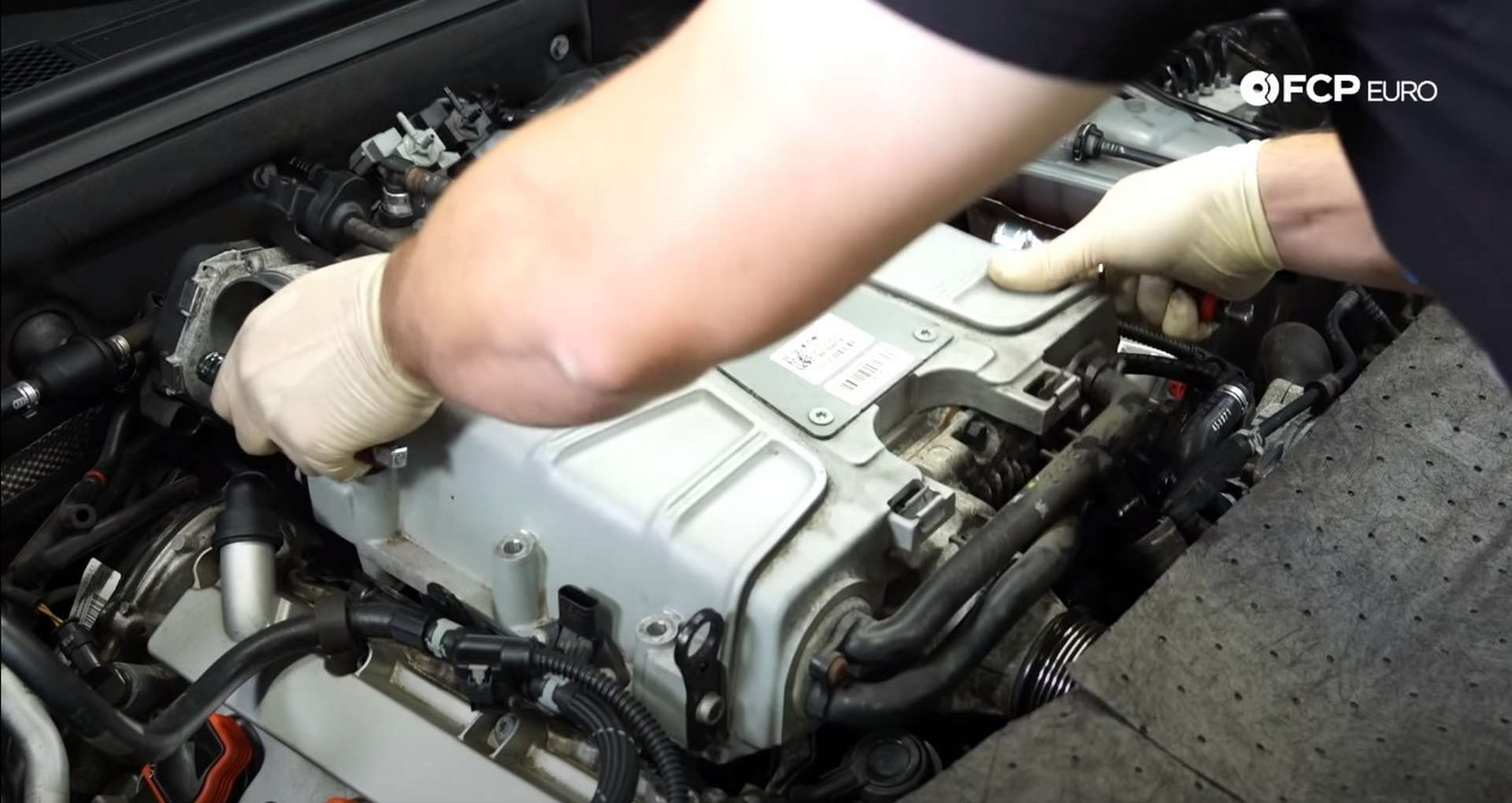 DIY Audi 3.0T Supercharger Oil Change removing the supercharger