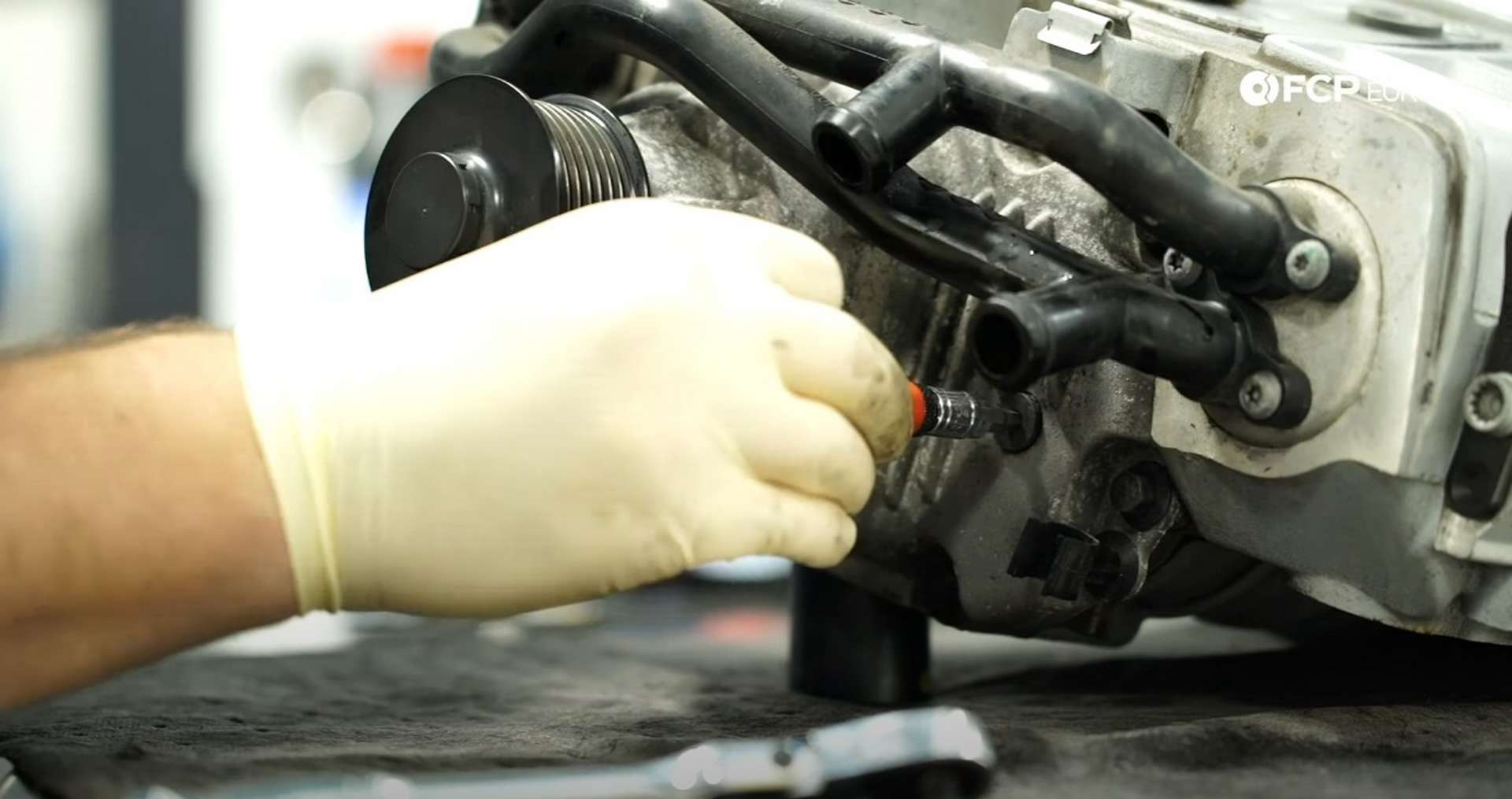 DIY Audi 3.0T Supercharger Oil Change removing the supercharger's fill plug