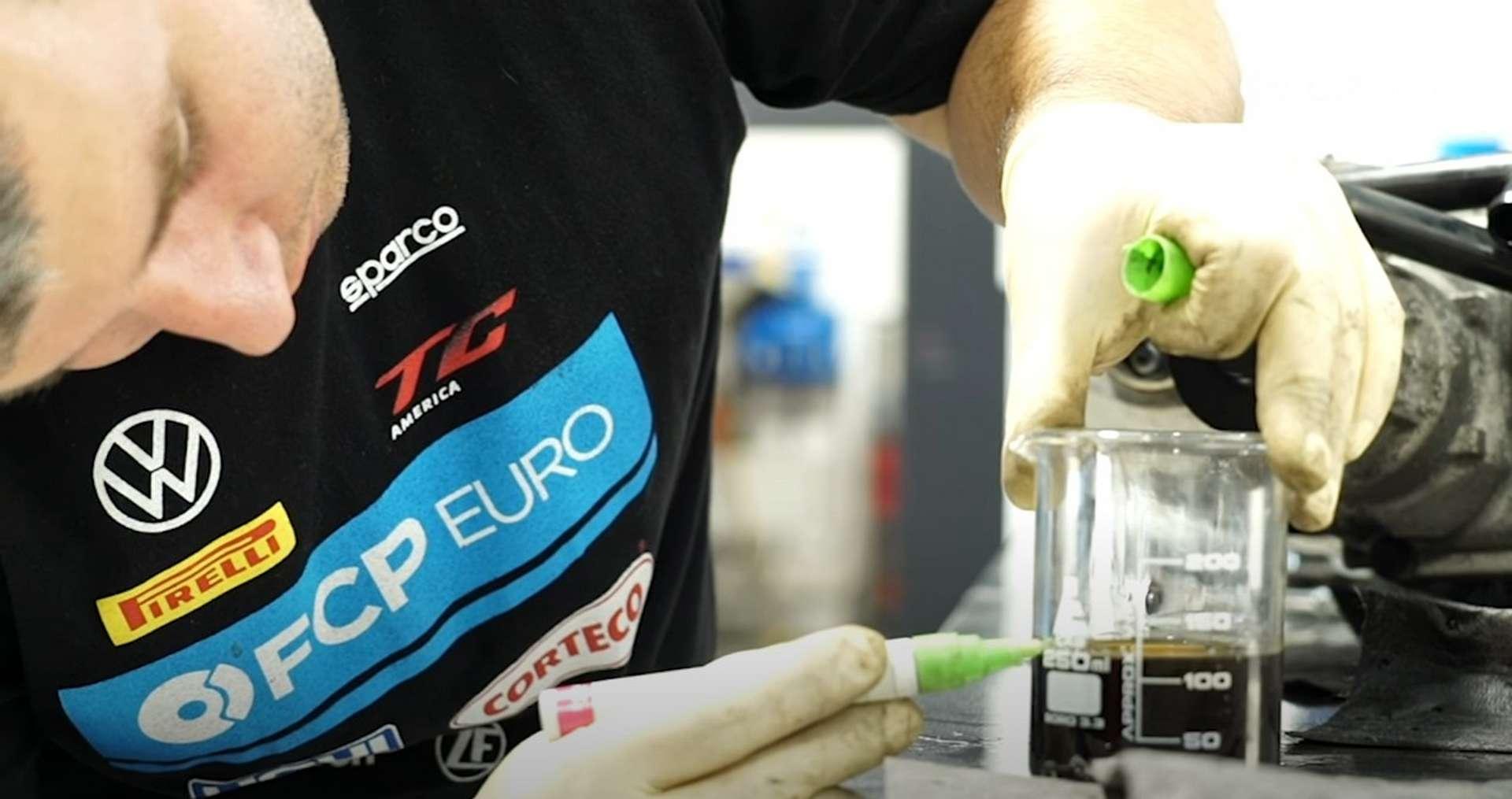 DIY Audi 3.0T Supercharger Oil Change measuring the supercharger oil